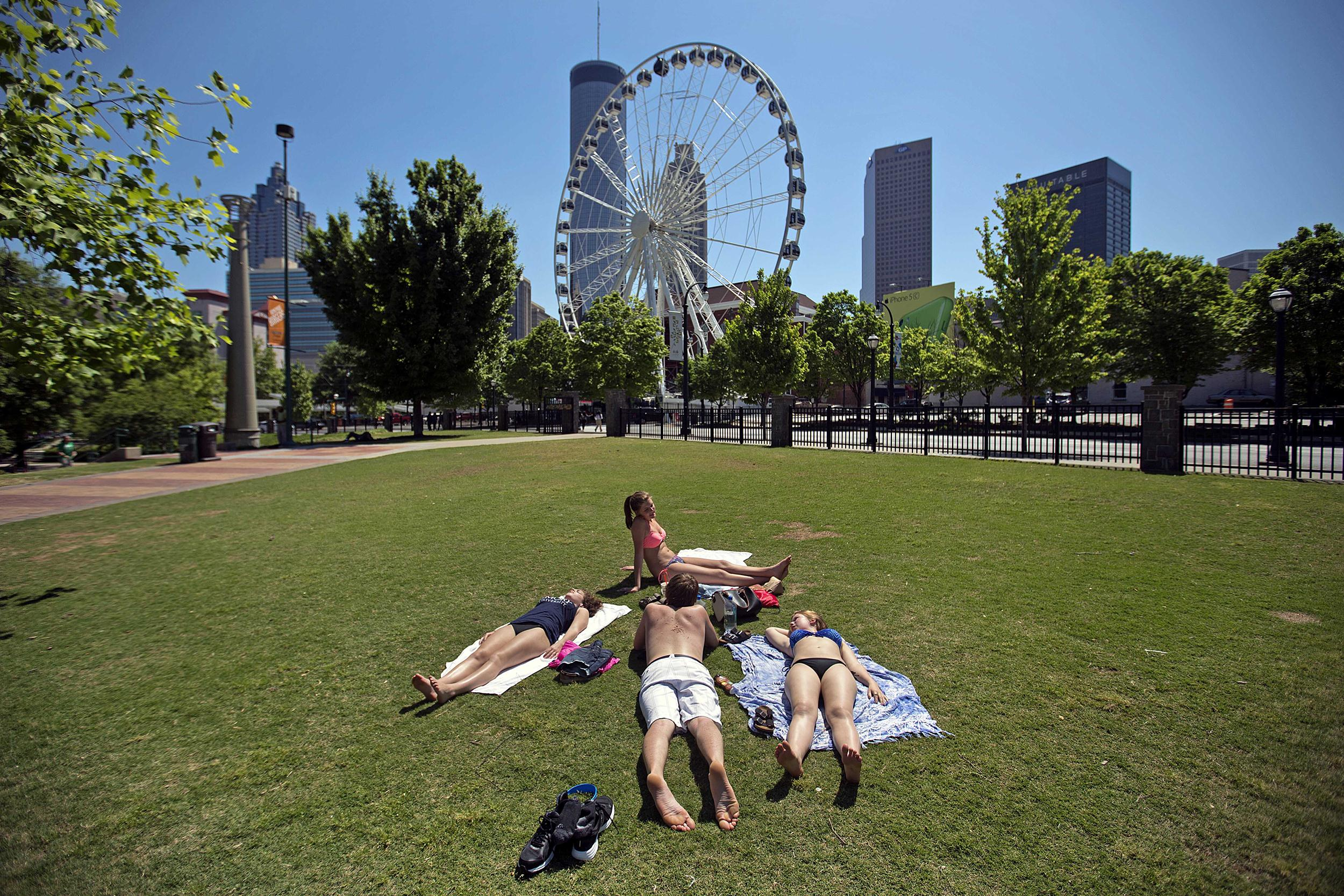 Image: Madison, Wis., high school students sunbathe in Centennial Olympic Park on May 6, in Atlanta
