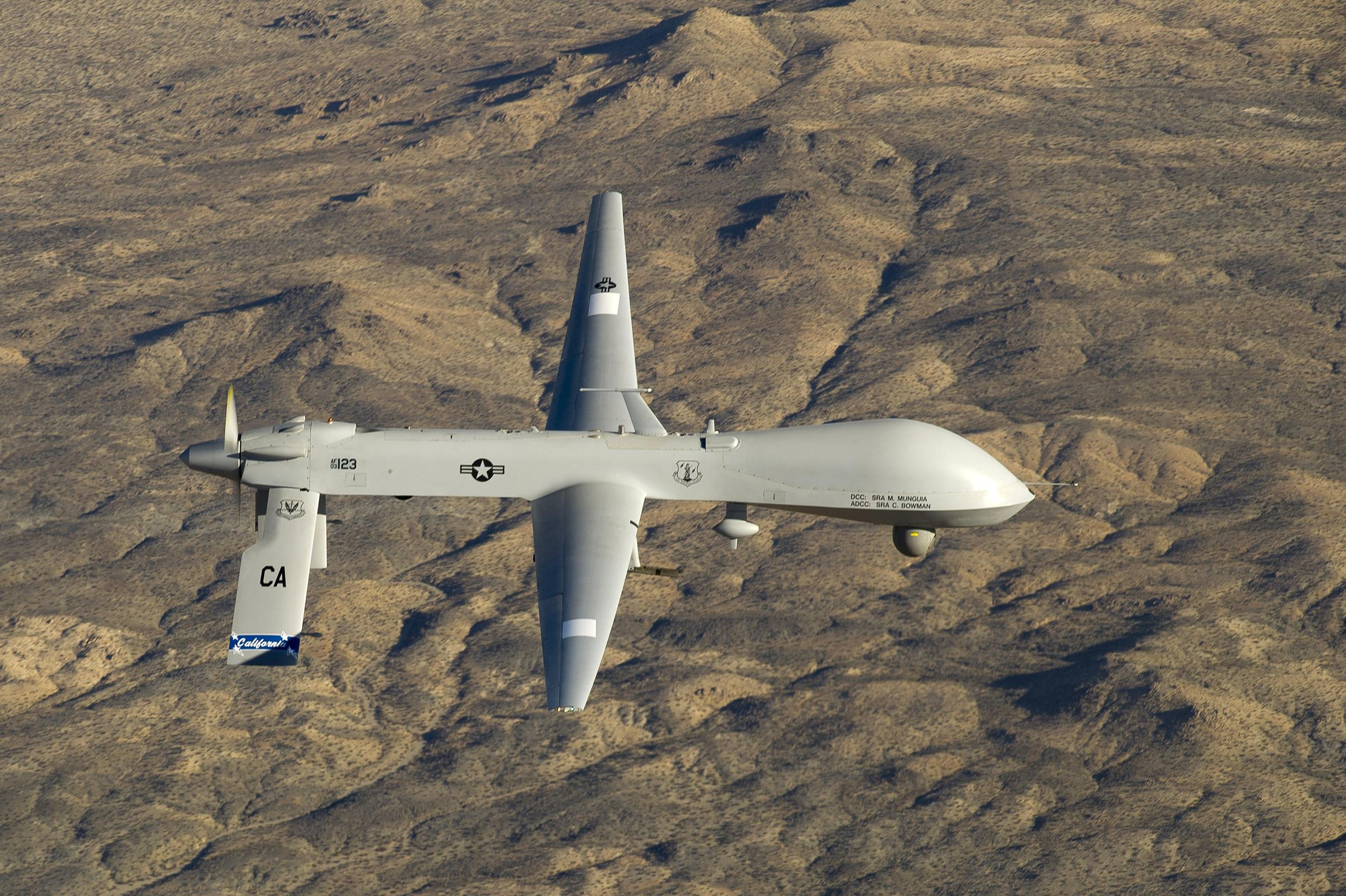 Image: A U.S. Air Force MQ-1 Predator unmanned aerial vehicle flies near the Southern California Logistics Airport in Victorville, Calif. on Jan. 7, 2012.