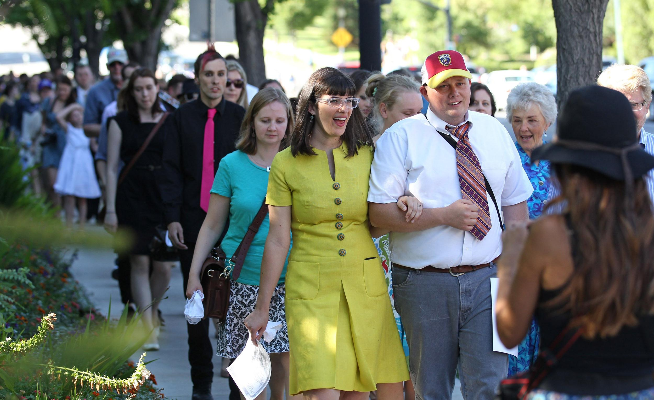 Image: Kate Kelly, center, walks with supporters to the Church Office Building of the Church of Jesus Christ of Latter-day Saints during a vigil
