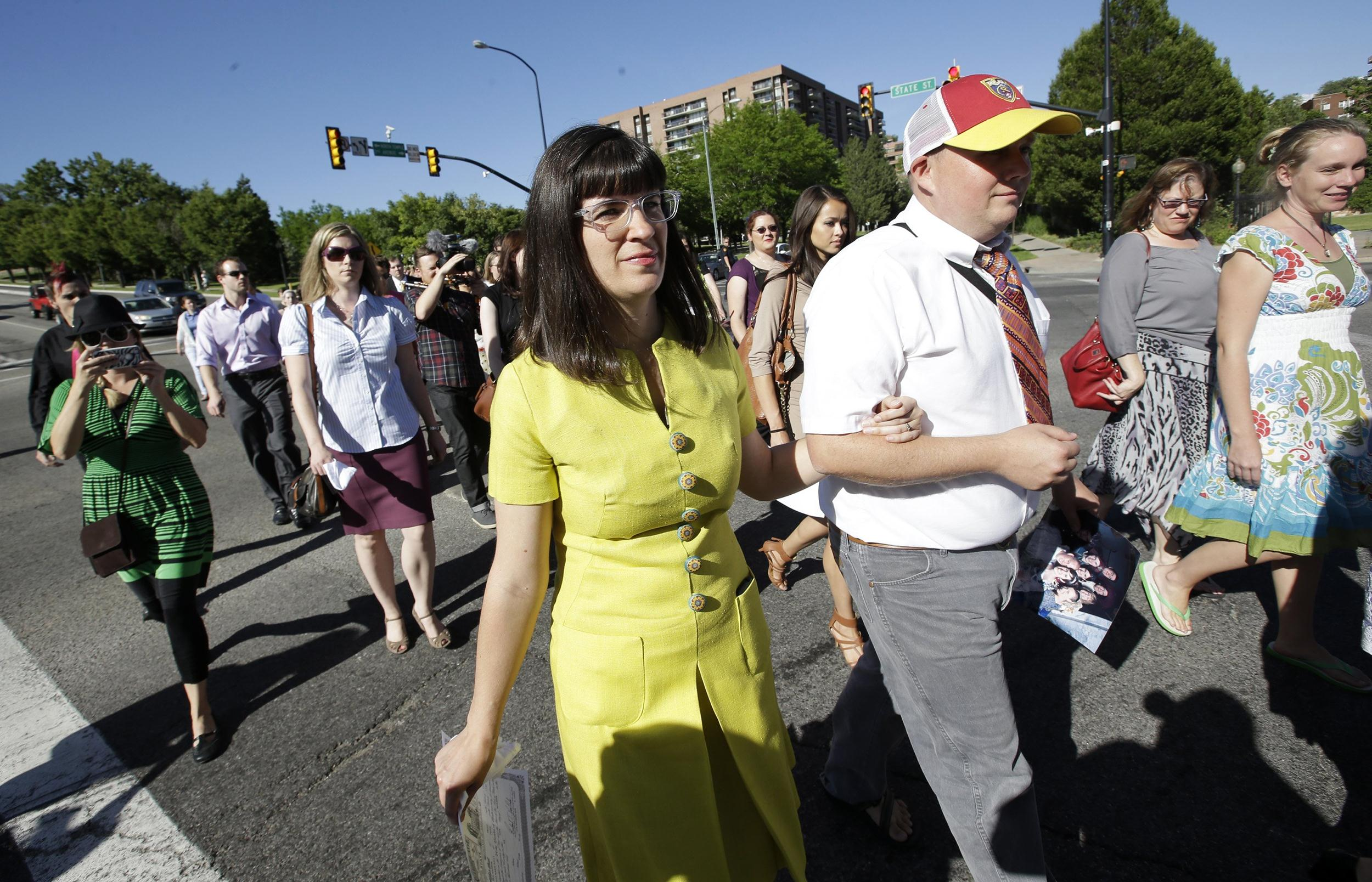 Image: Kate Kelly, left, walks with supporters to the Church Office Building of the Church of Jesus Christ of Latter-day Saints