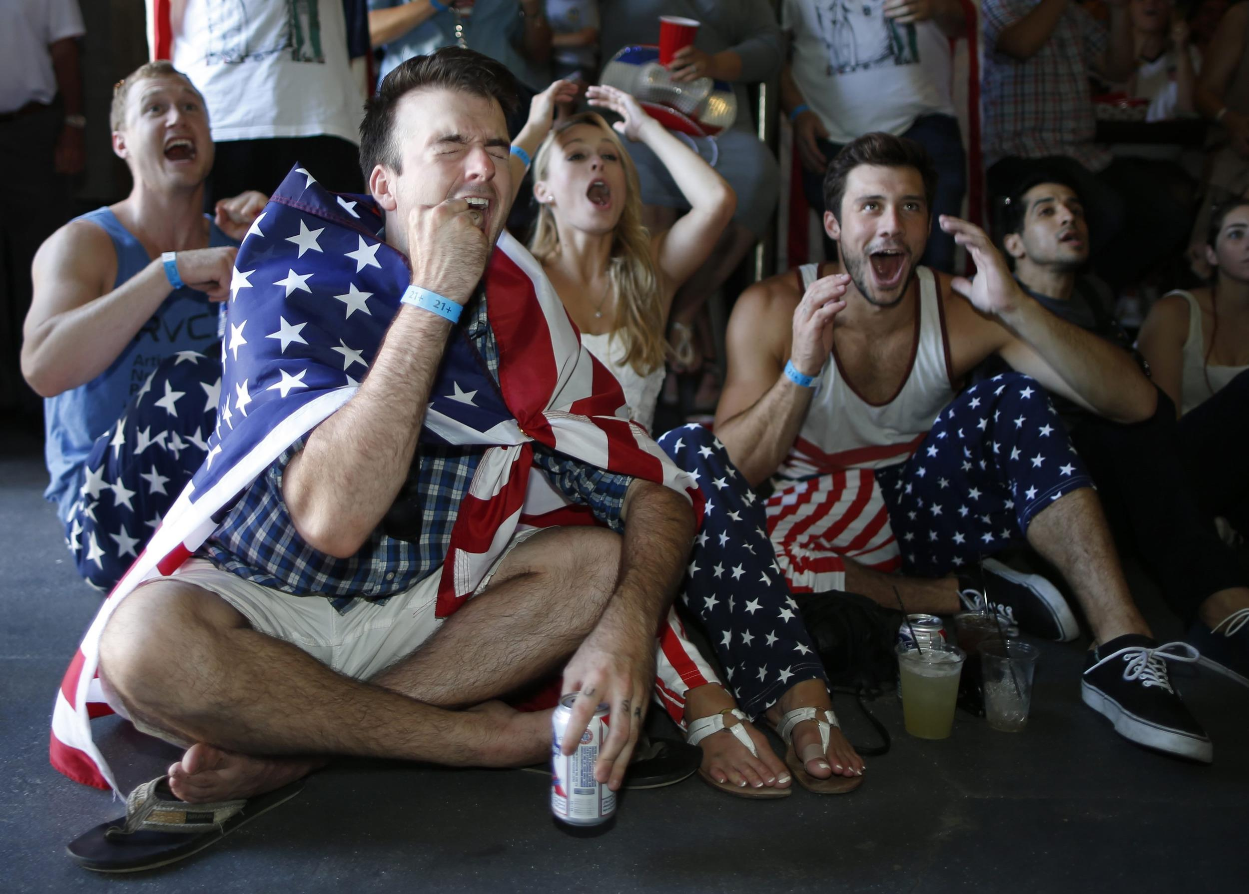 Image: USA fans react during the 2014 World Cup Group G soccer match between Portugal and the U.S. at a viewing party in Los Angeles