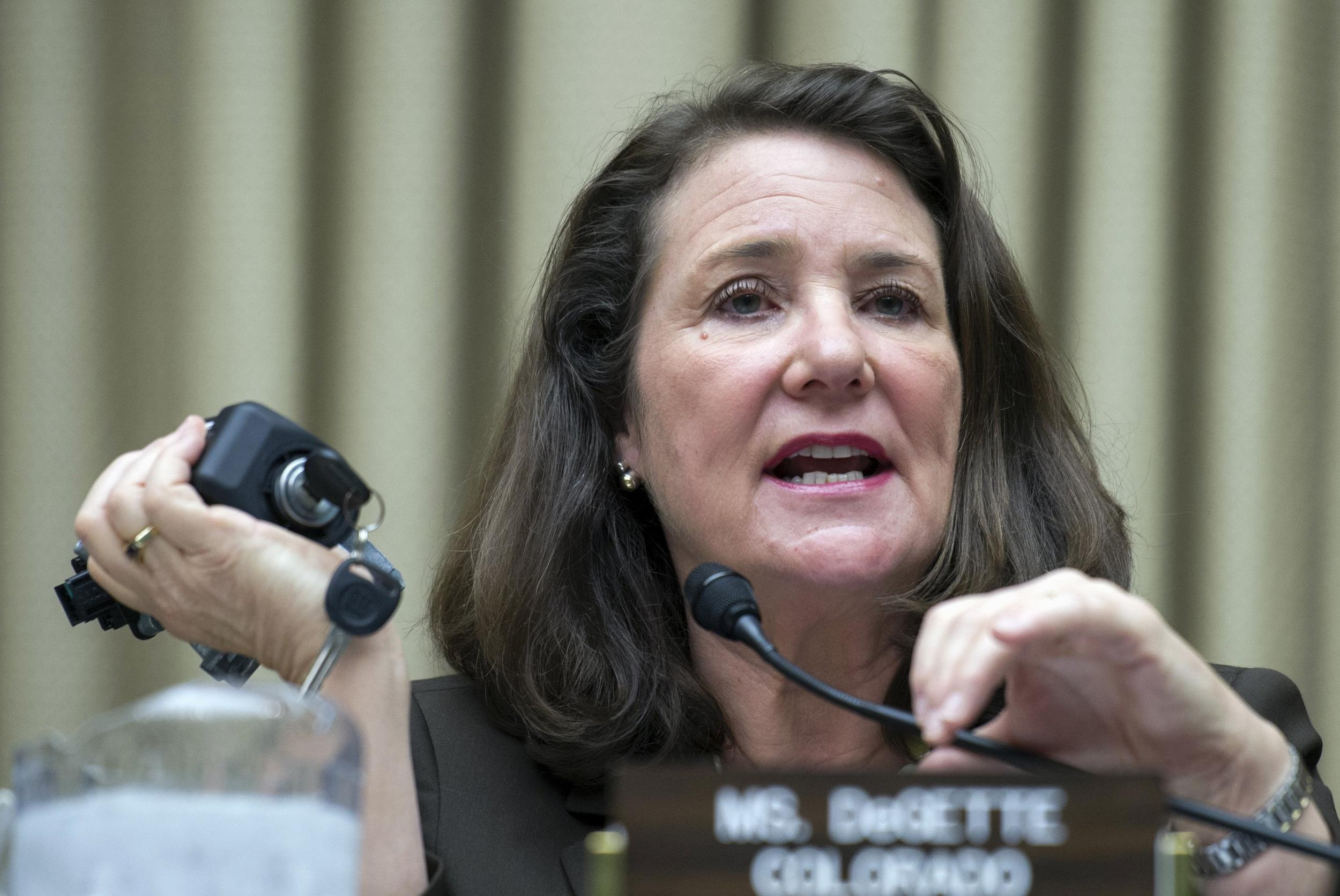 Rep. Diana DeGette holds an ignition switch unit at a House committee hearing into General Motors' recalls. GM says a switch linked to the latest recalls was made in China.