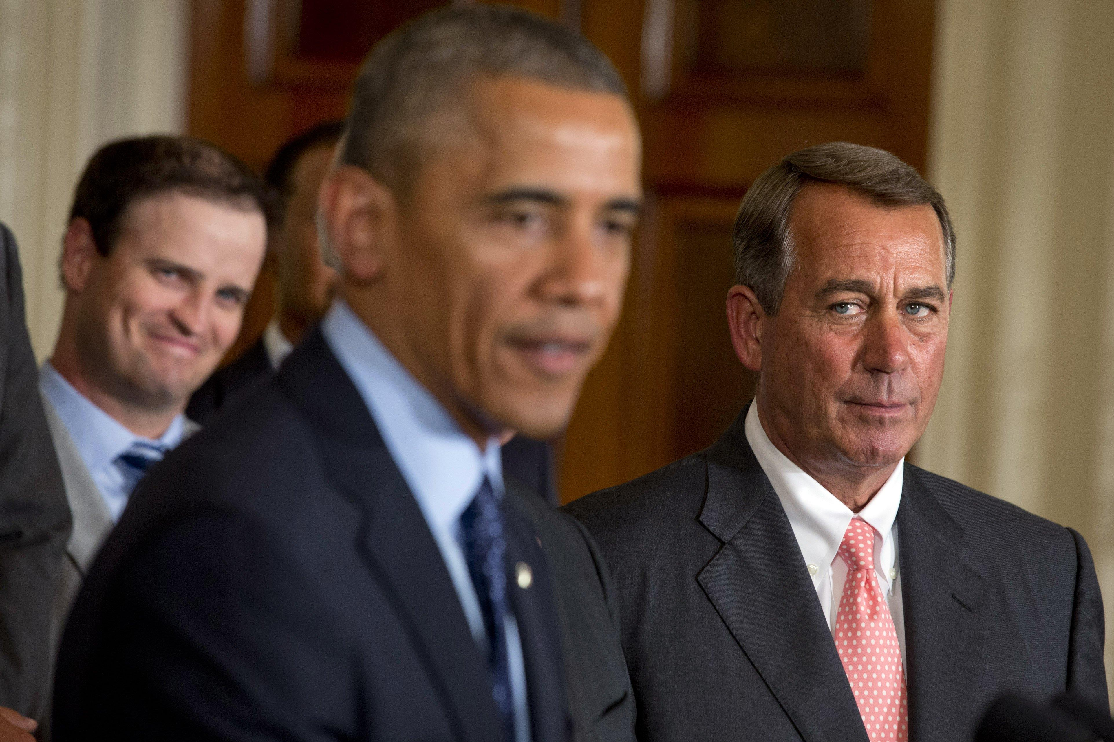 Image: Barack Obama, John Boehner, Zach Johnson