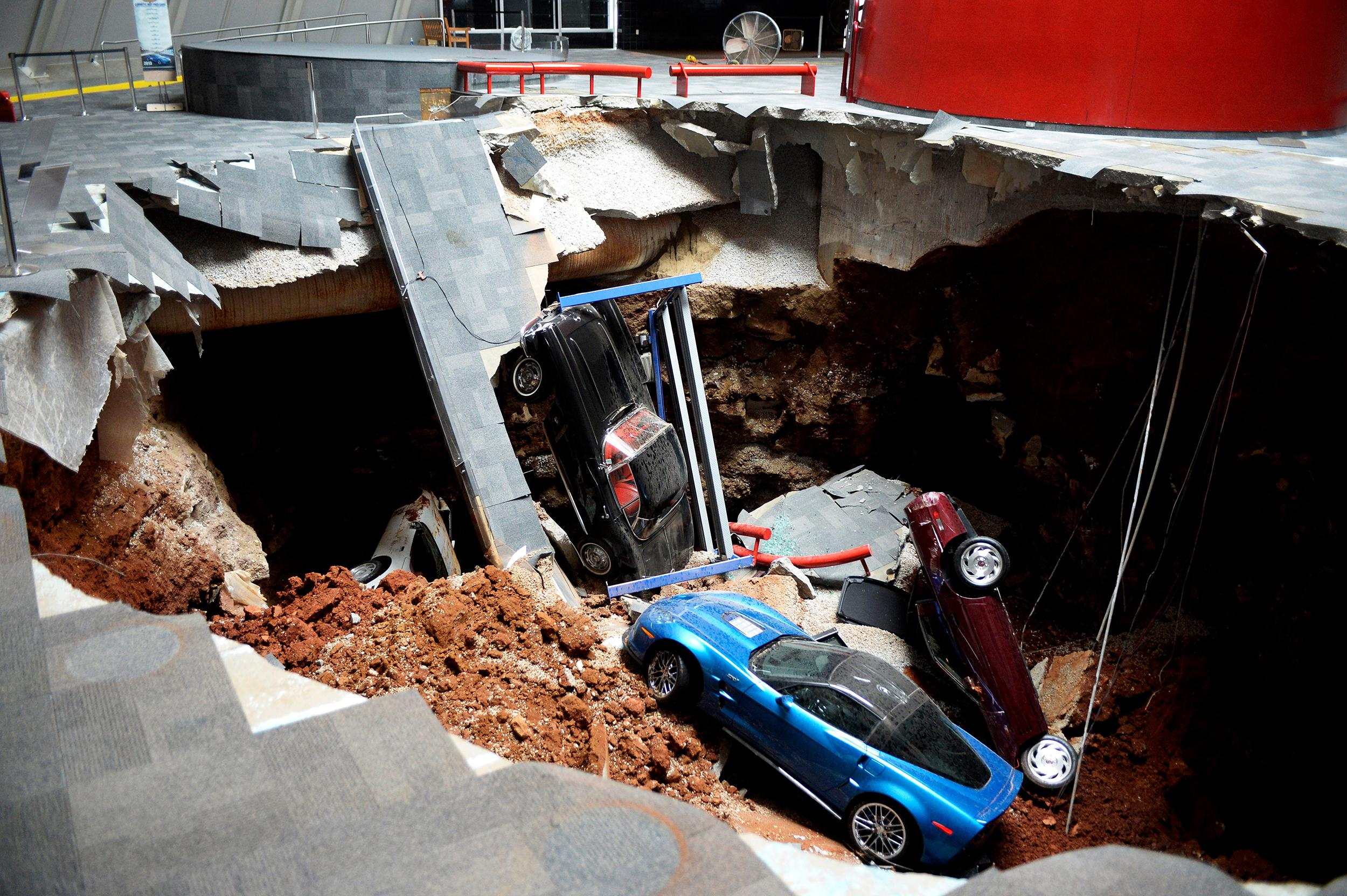Image: A view of a sinkhole that opened up in the Skydome showroom on Feb. 12, at the National Corvette Museum in Bowling Green, Ky.