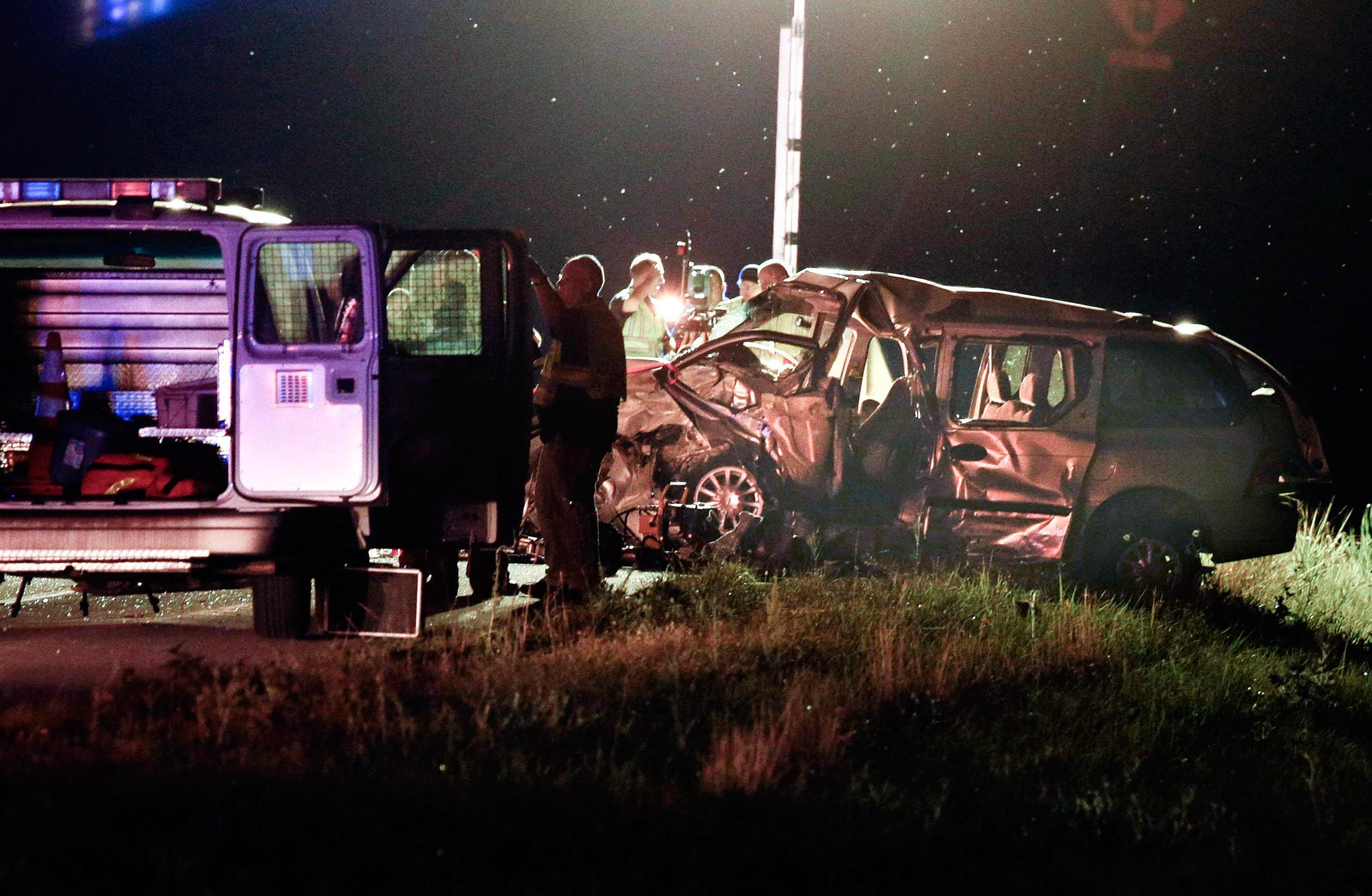 Image:  Rescue personnel and police investigate a deadly two-vehicle crash on U.S. 27 in Nicholasville, Ky.