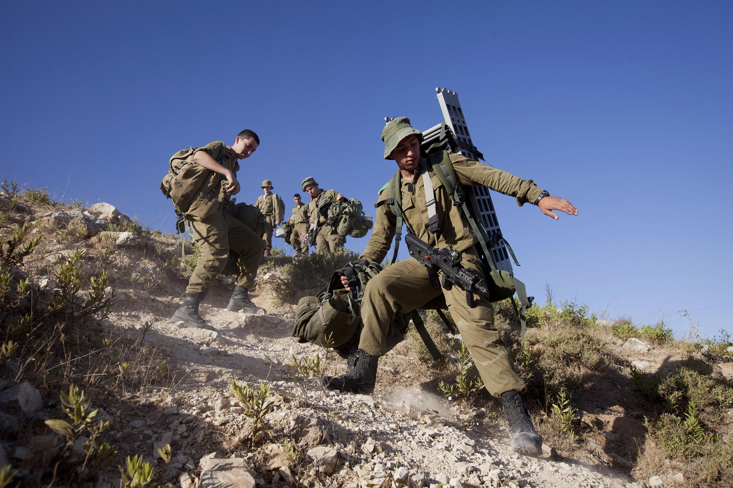 Image: Israeli soldiers search for three missing teens, in the town of Halhul near the West Bank city of Hebron, on June 24.