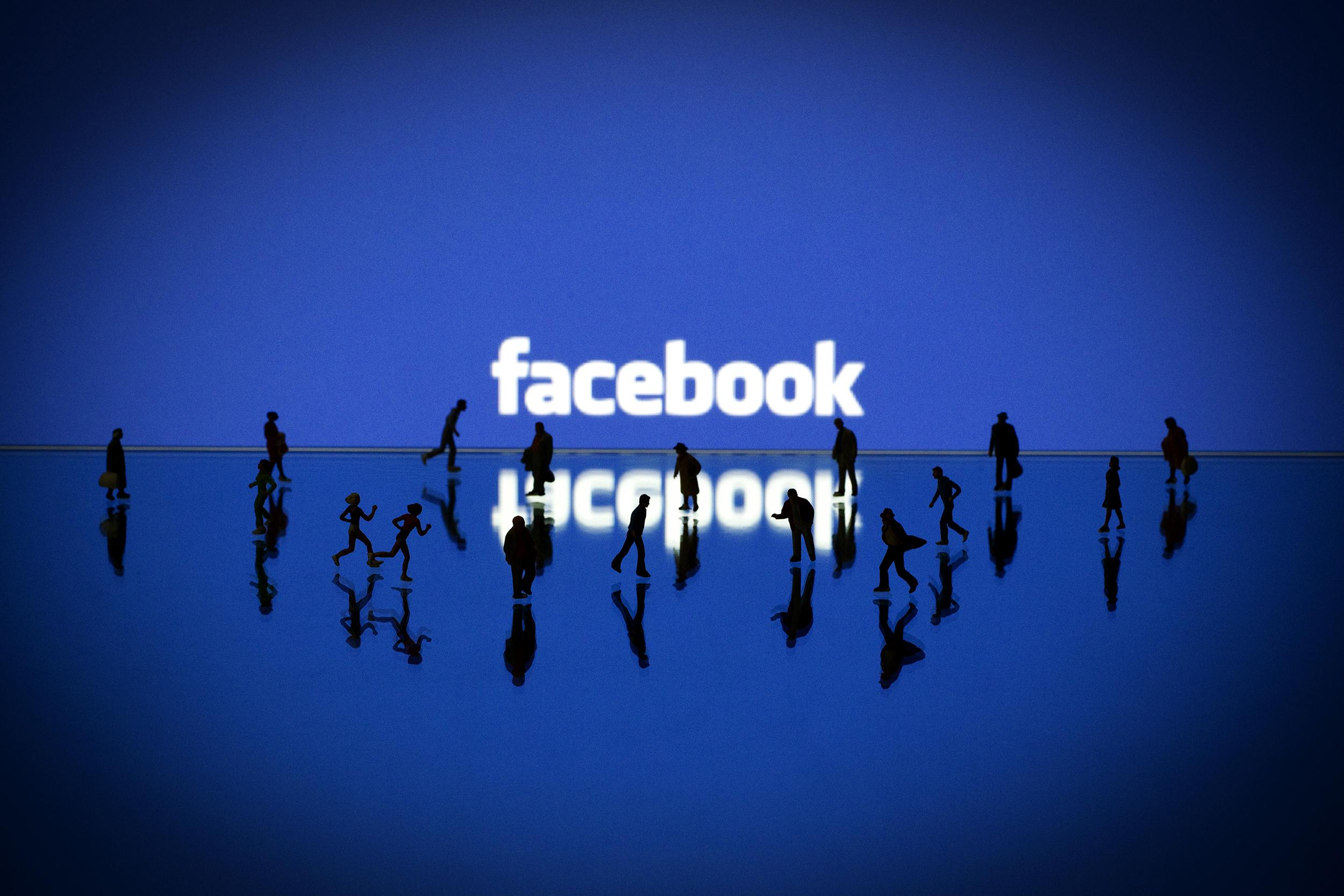 Image: An illustration made with figurines set up in front of Facebook's homepage on May 12, 2012.