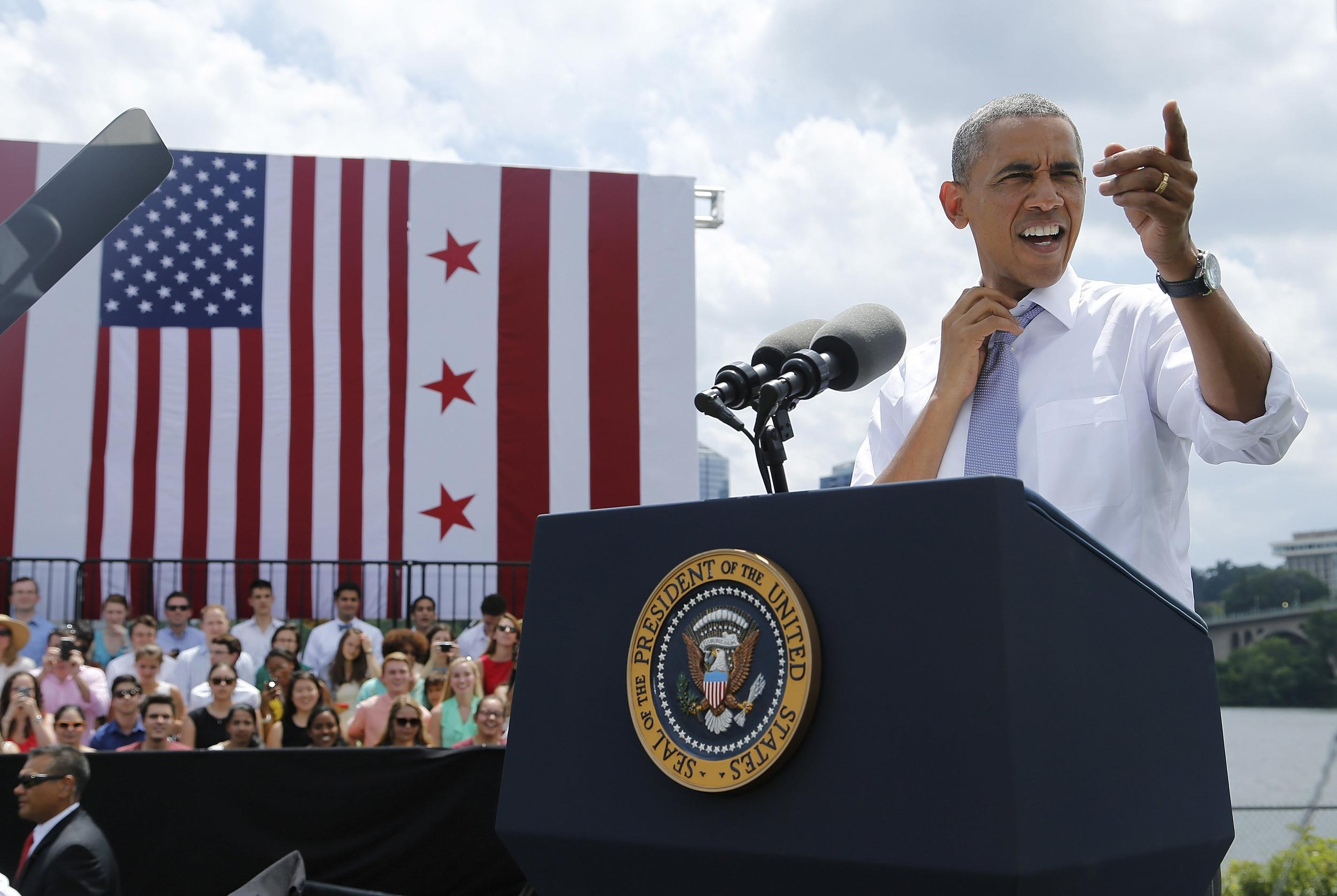 Image: U.S. President Obama loosens his tie in the heat before delivering remarks on the economy at the Georgetown Waterfront Park in Washington