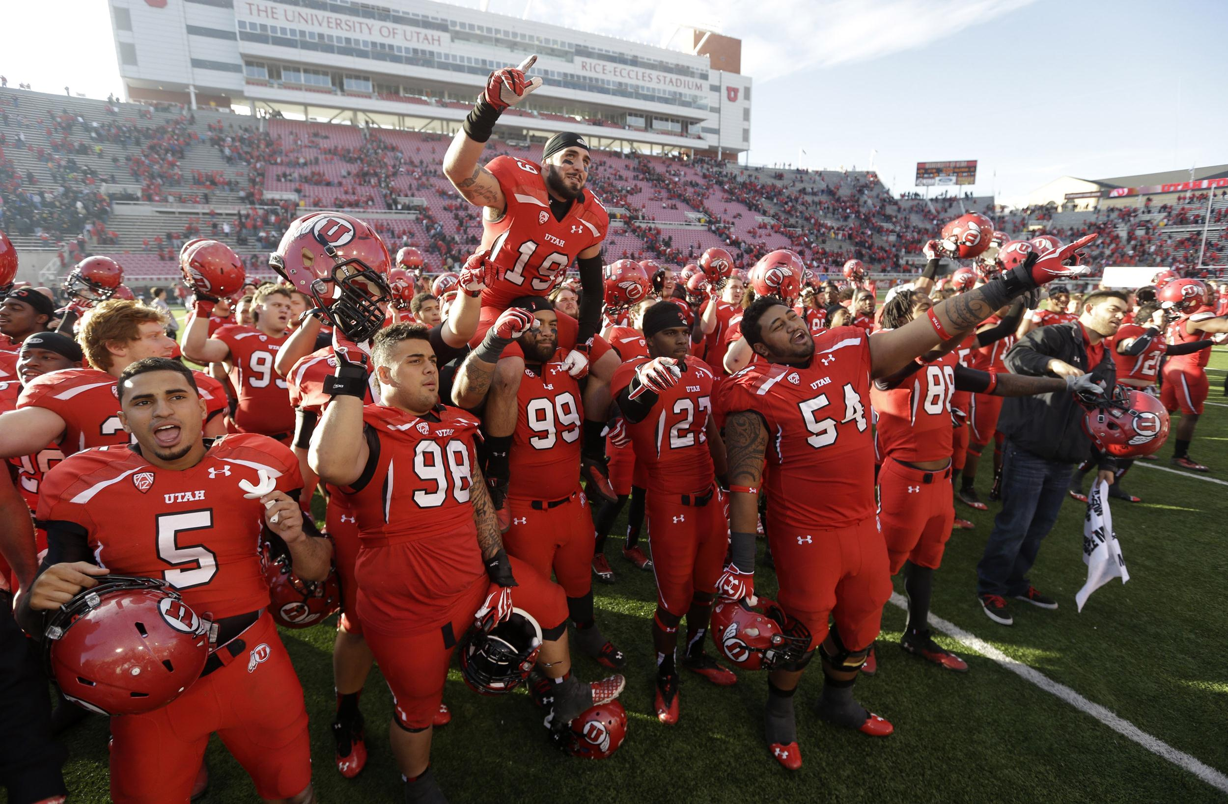 Image: Utah players celebrate after game against Colorado on Nov. 30