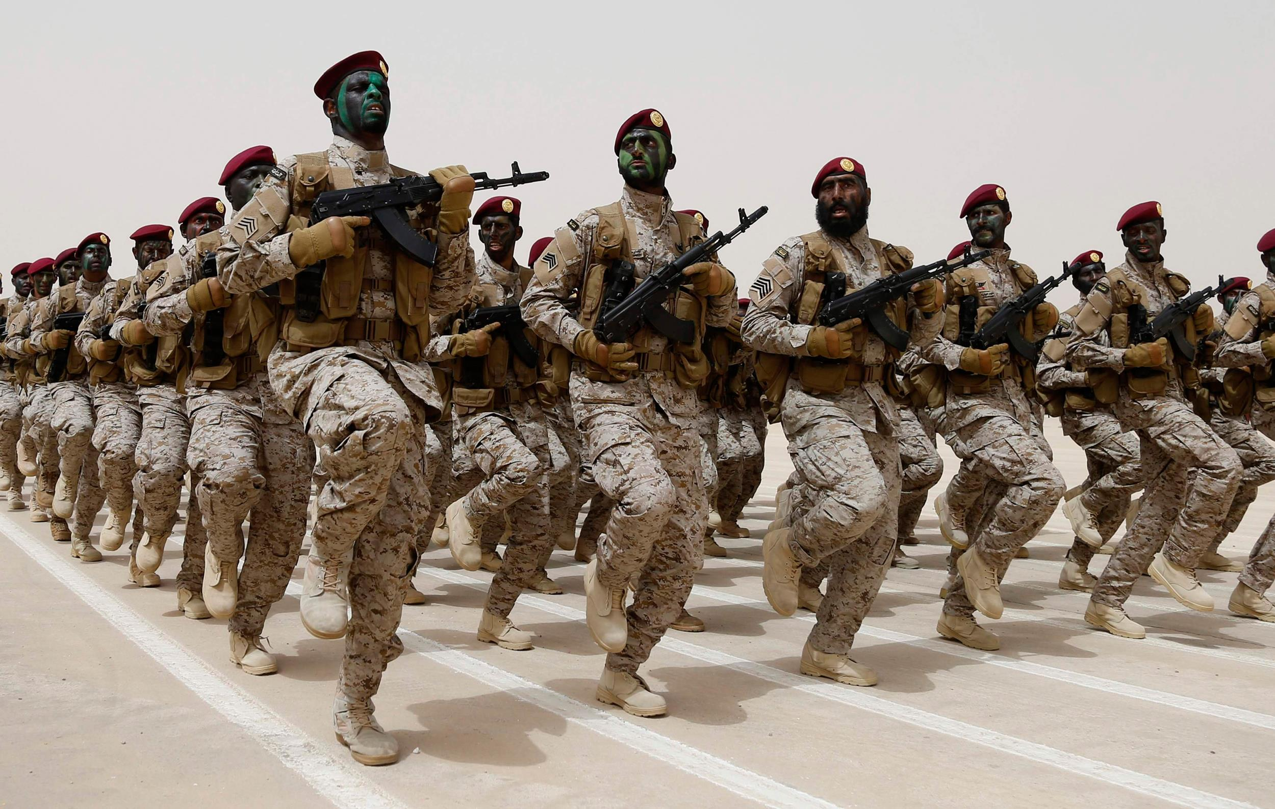 Image: Saudi soldiers march during Abdullah's Sword military drill in Hafar Al-Batin, near the border with Kuwait
