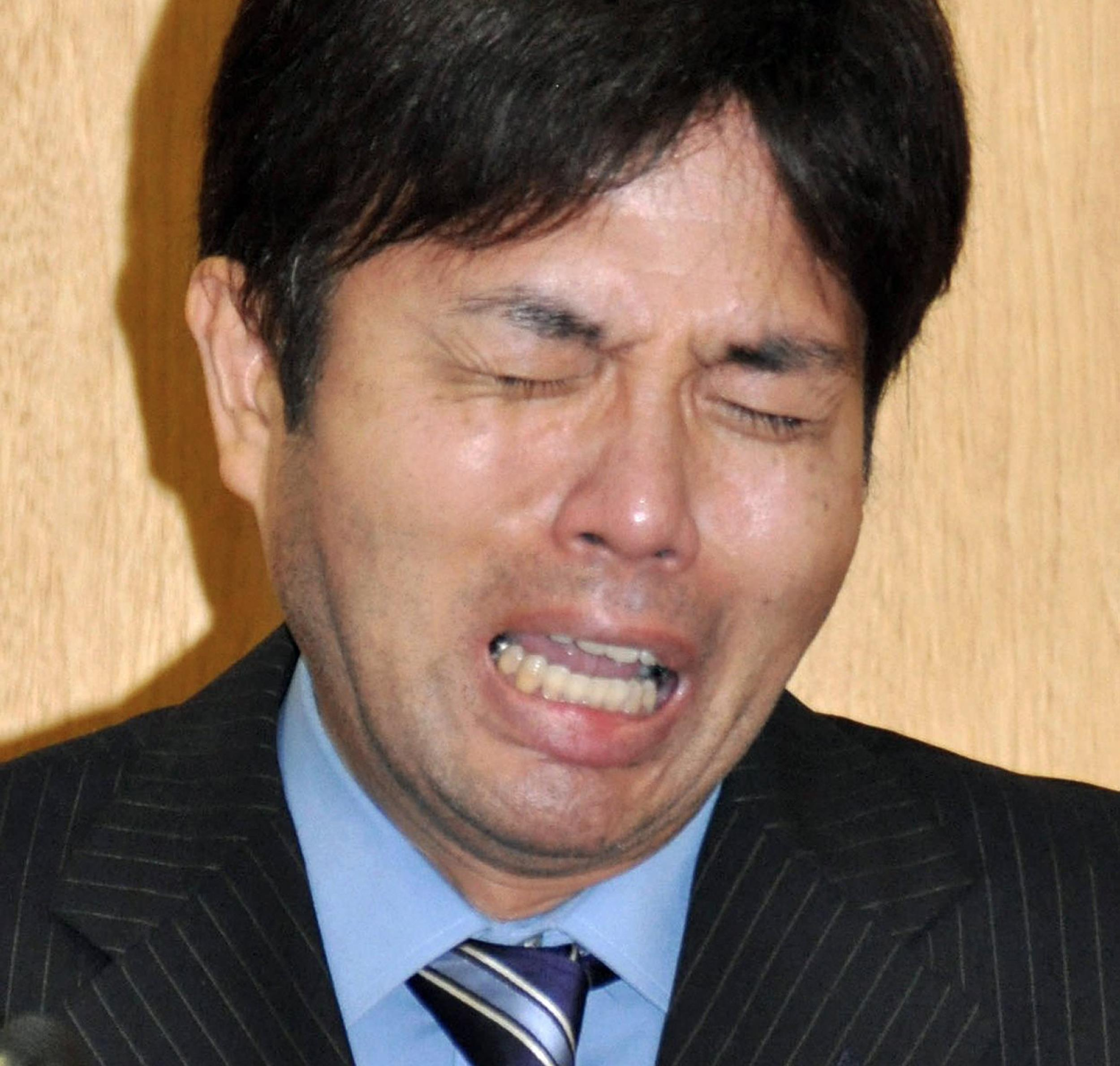 Image: Ryutaro Nonomura cries during a press conference in Kobe, western Japan.