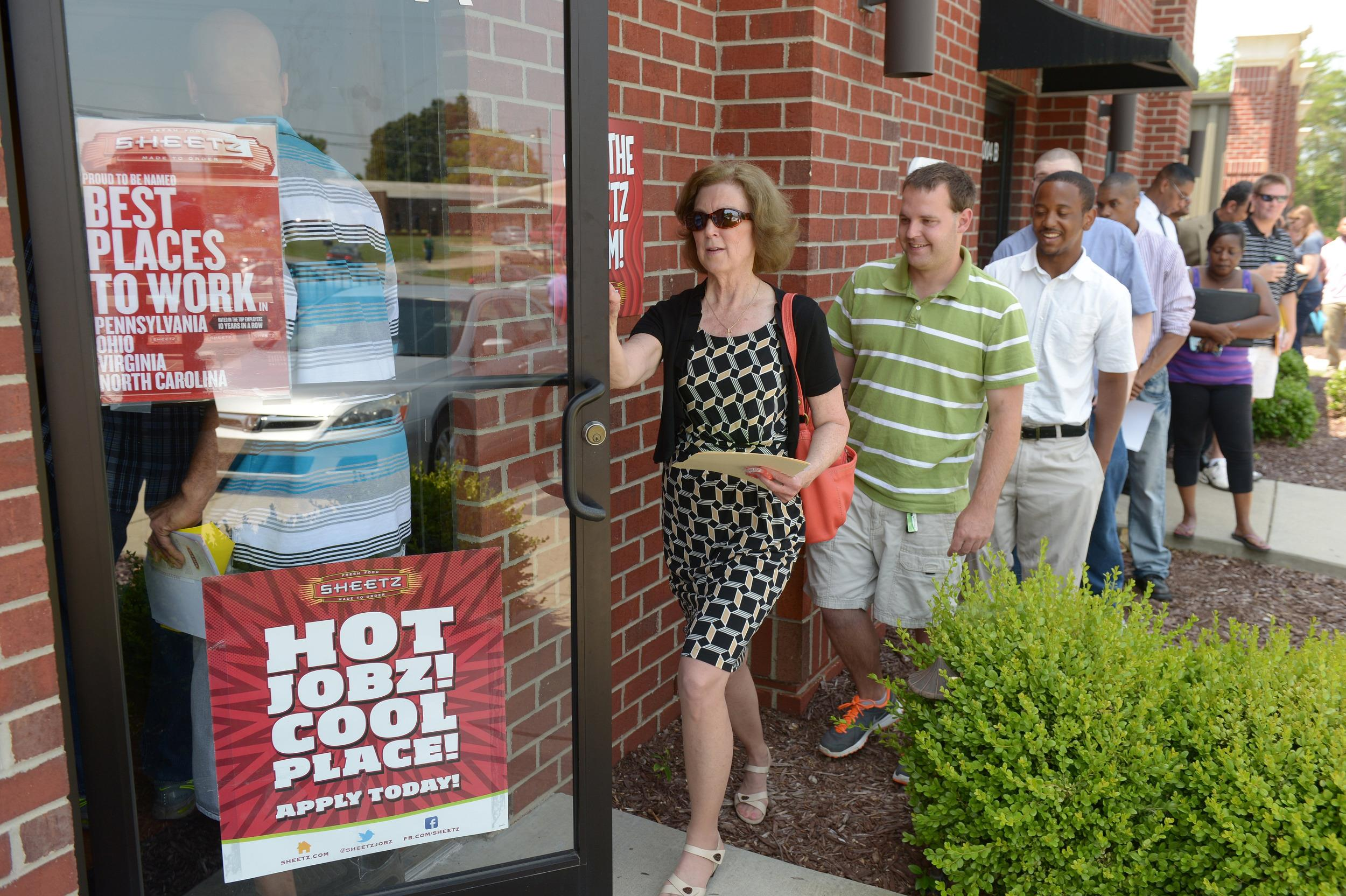 Job seekers attend a job fair held by Sheetz to staff their under-construction distribution center, in Burlington, N.C.