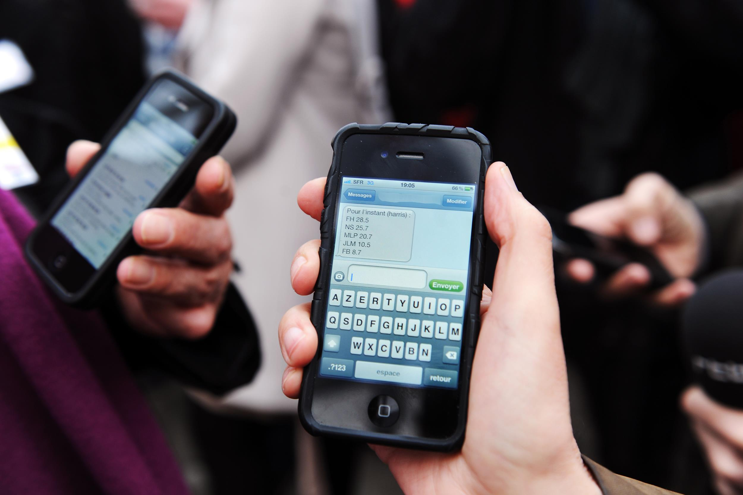 Image: People receive messages on their mobile phone