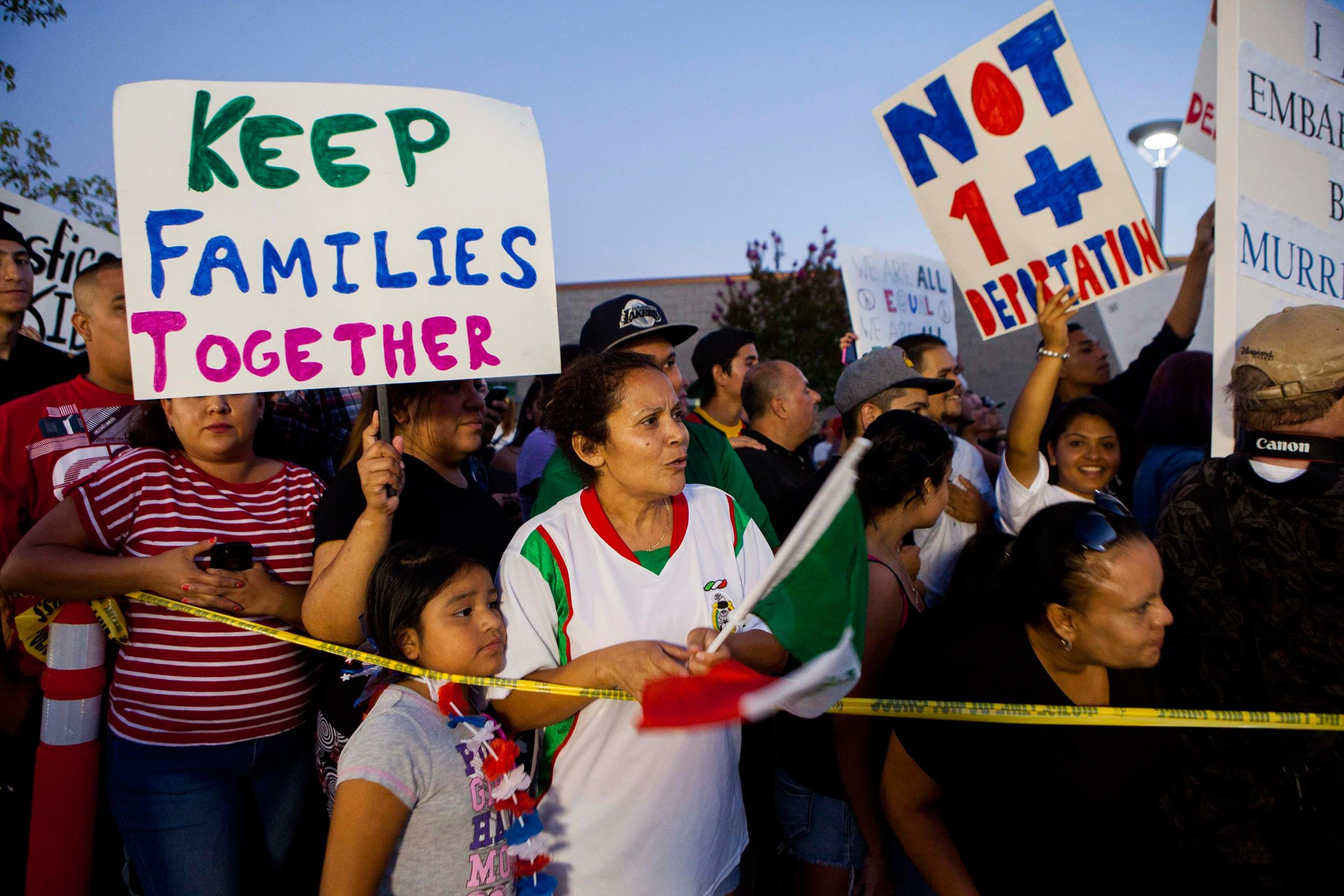 Image: Residents and protestors attend a town hall meeting to discuss the processing of undocumented immigrants in Murrieta, Calif.