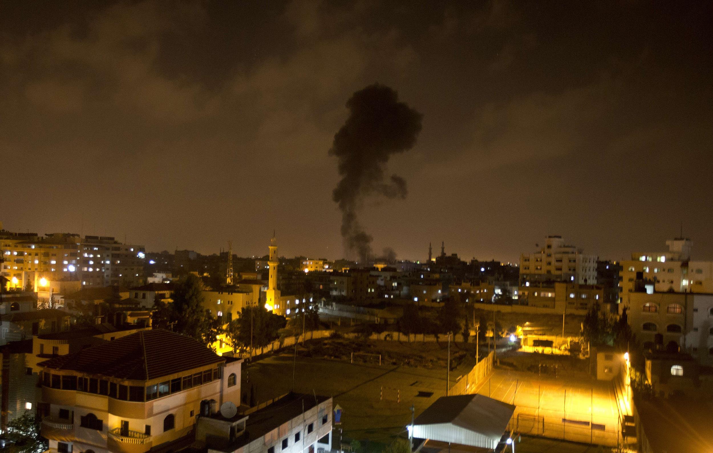 Image: Smoke rises after an Israeli missile strike hit Gaza City on July 07,