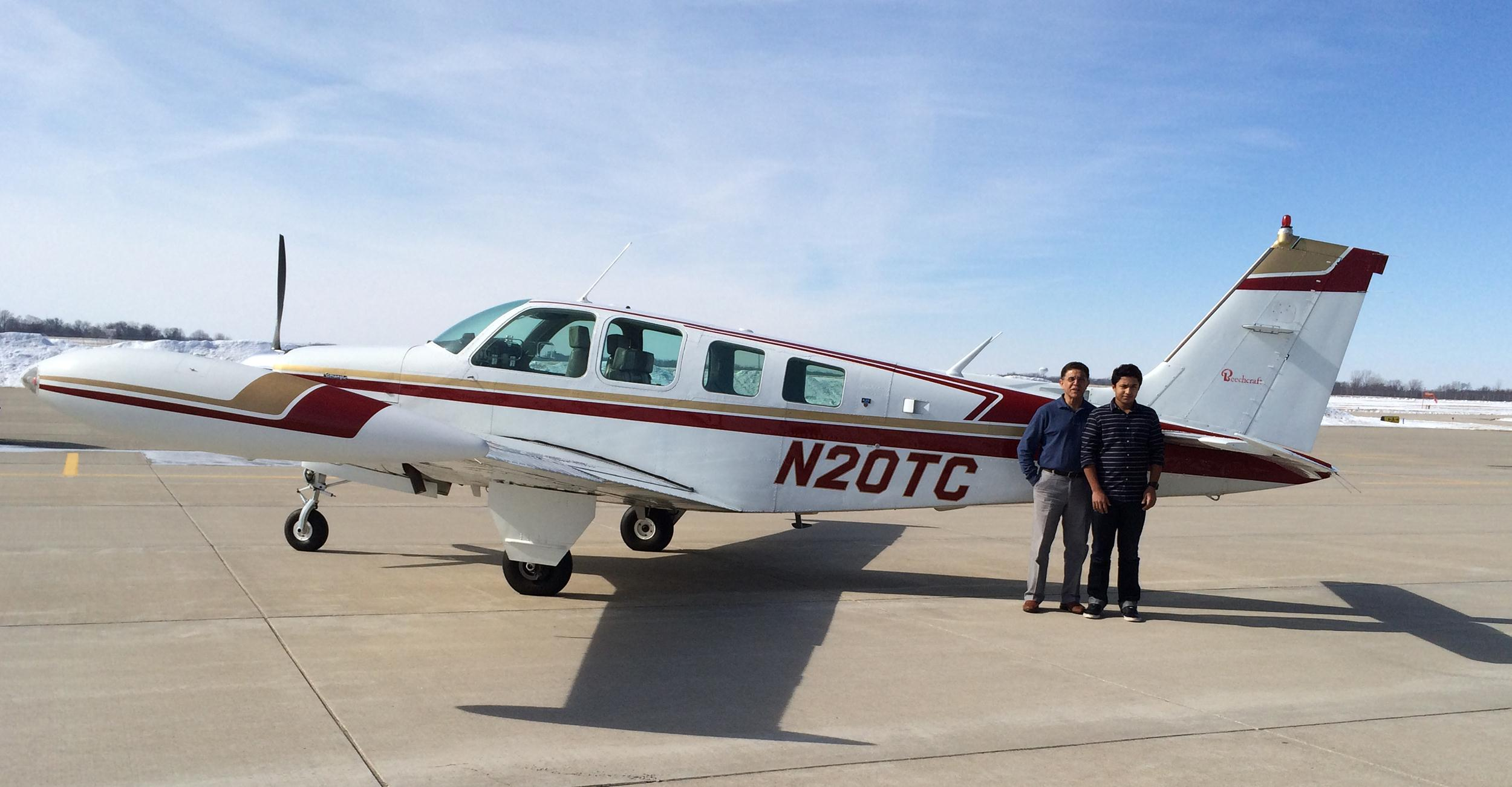 Image: Babar Suleman, left, and son, Haris Suleman, right, are flying their Beechcraft Bonanza plane across the globe, and will visit about two-dozen countries.