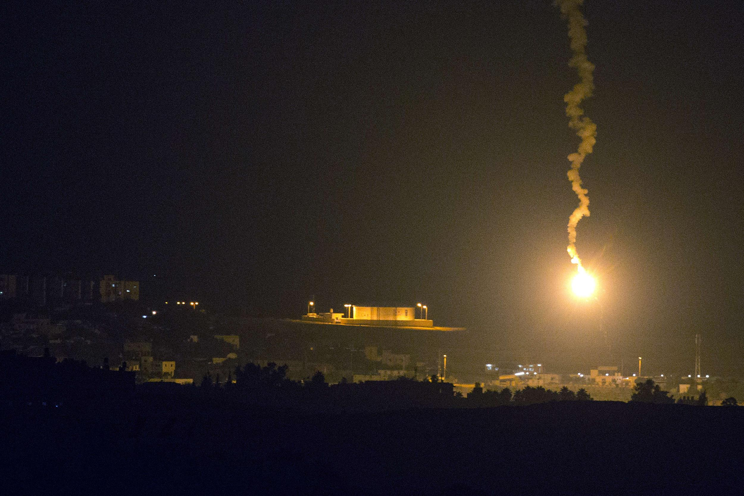 Image: Israeli flares illuminates part of the Israel/Gaza border.