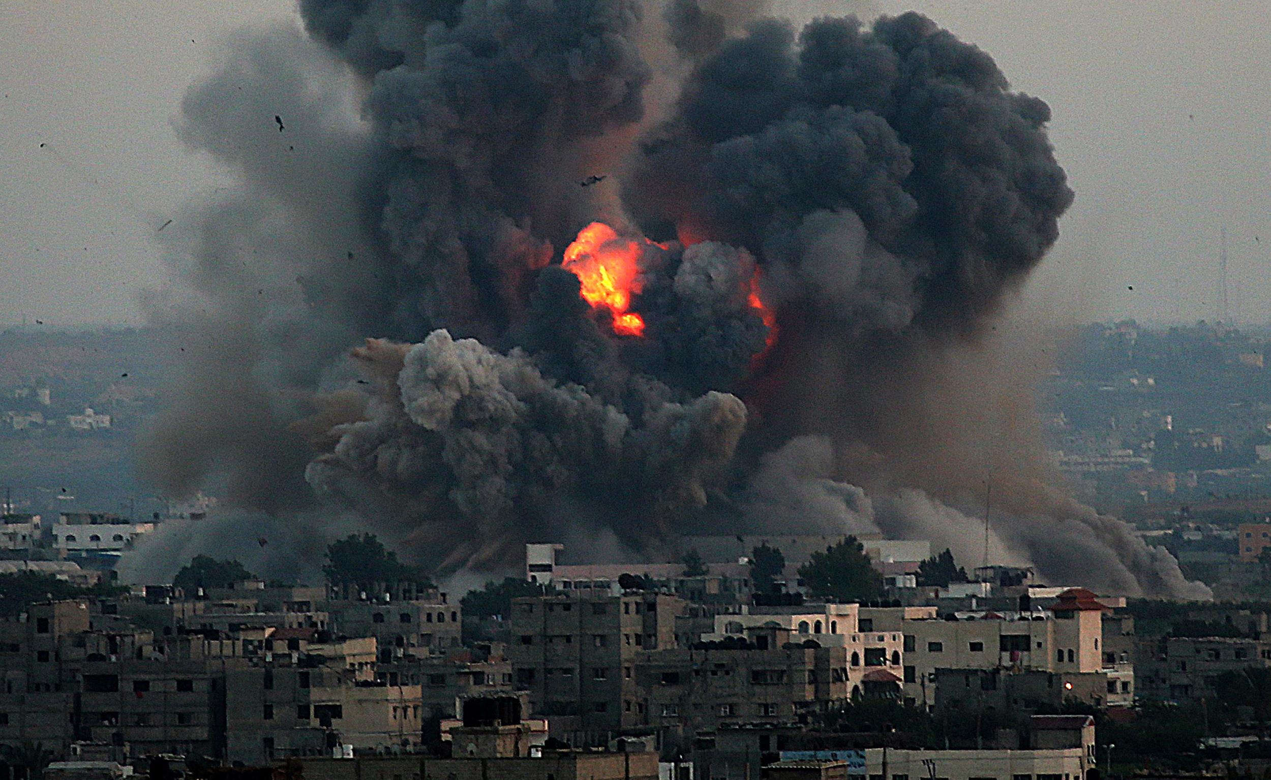 Image: Smoke rises after an attack of Israeli aircraft in the South of Gaza City