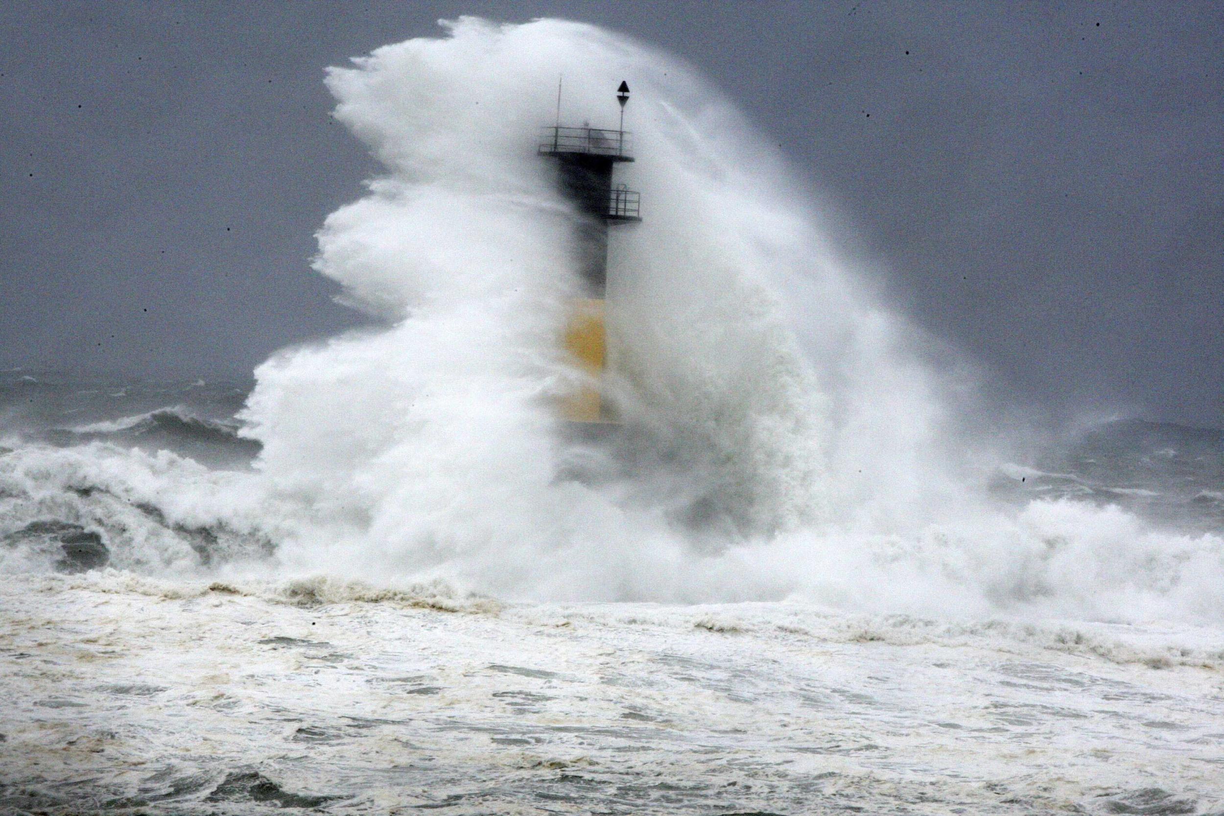 Image: Waves hit lighthouse on Japan's Jeju Island