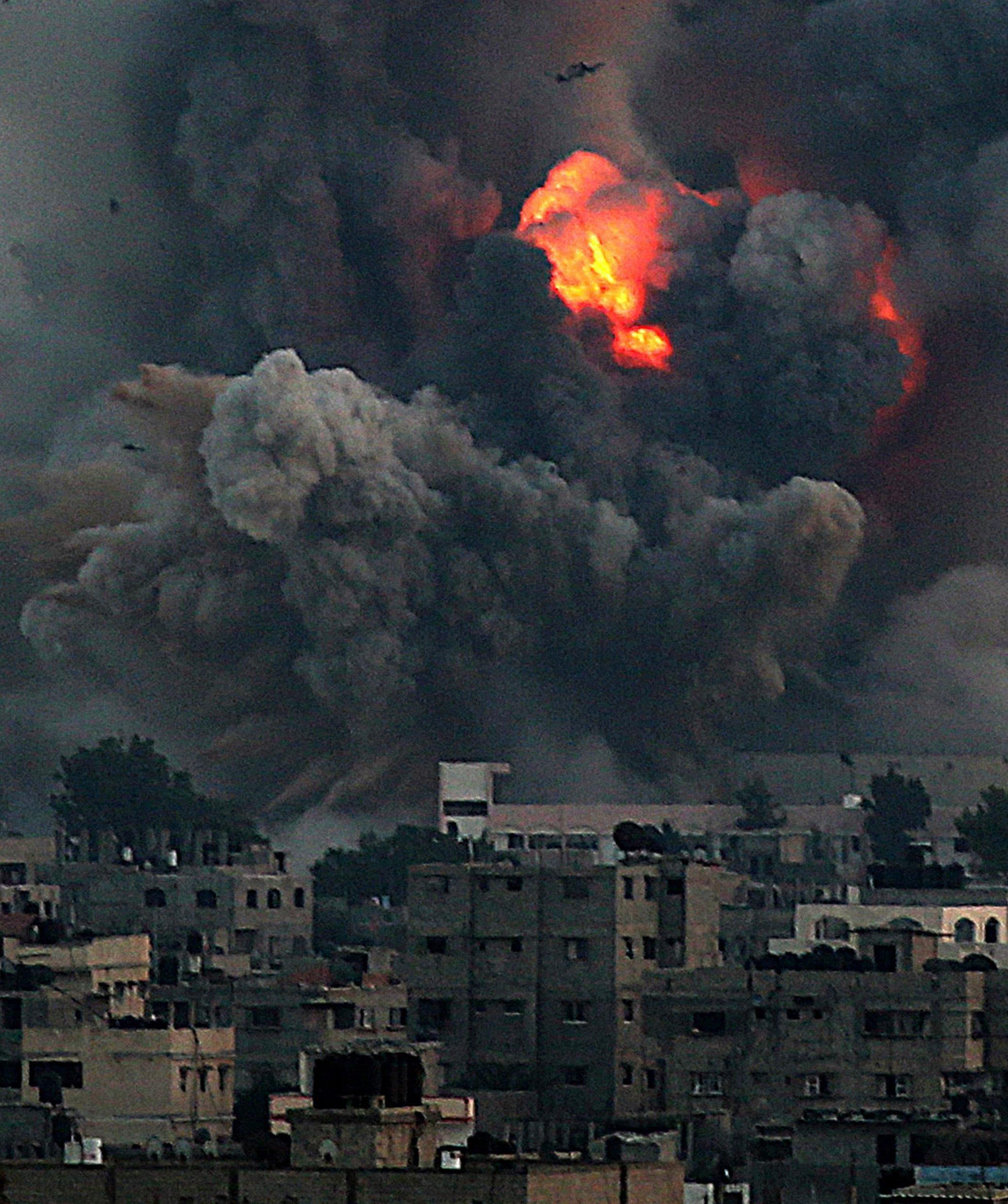 Image: Smoke rises after Israeli airstrike in Gaza City on Tuesday