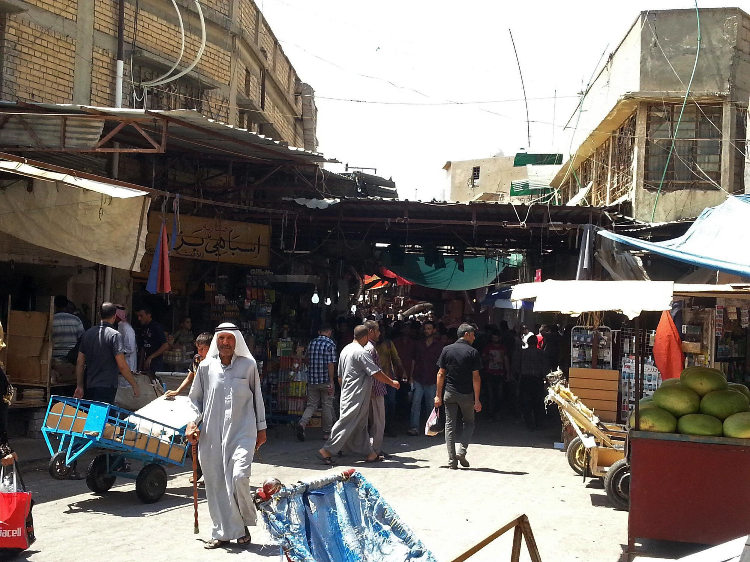 Image: Residents shop ahead of the Muslim fasting month of Ramadan at a market in the city of Mosul