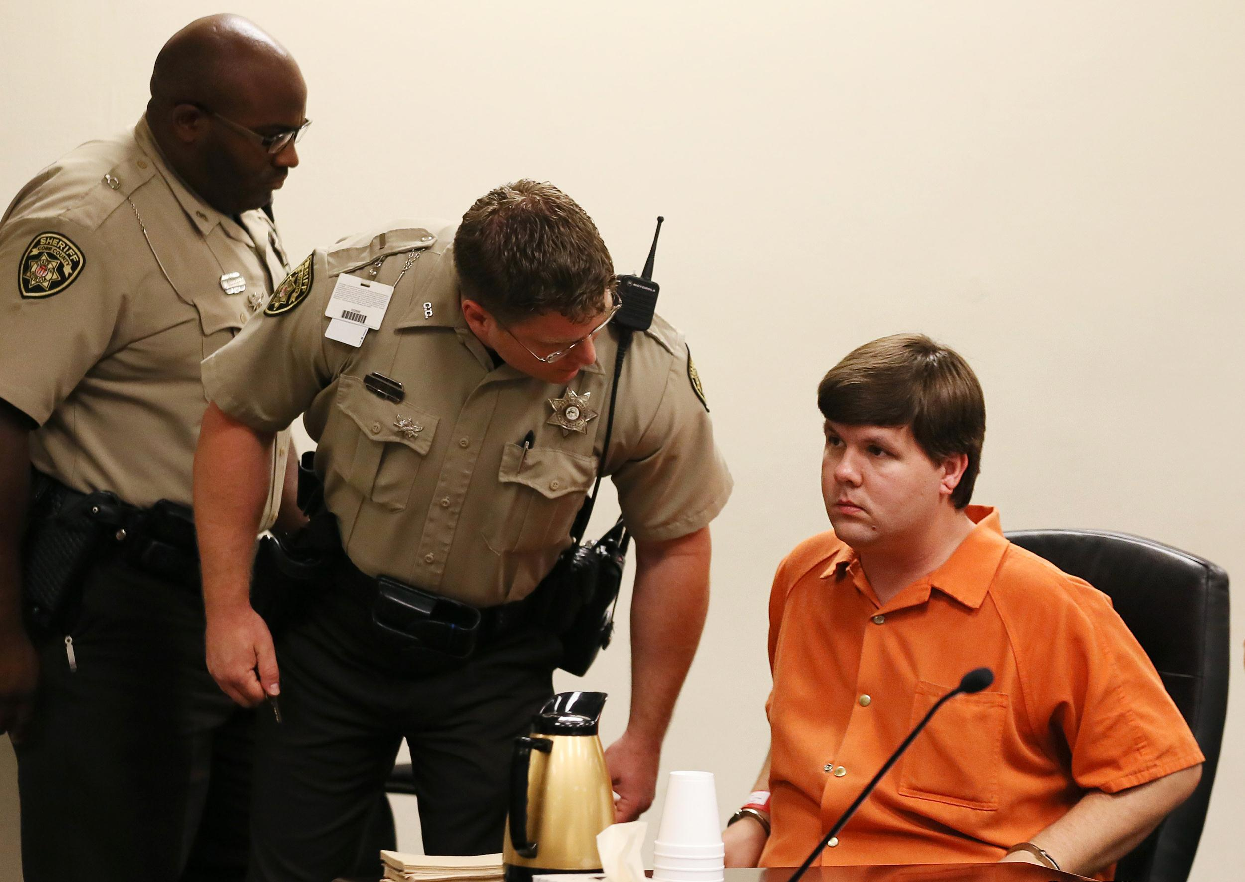 Image: A Cobb County Sheriff's deputy talks to Ross Harris, right, the father of a toddler who died in a hot car