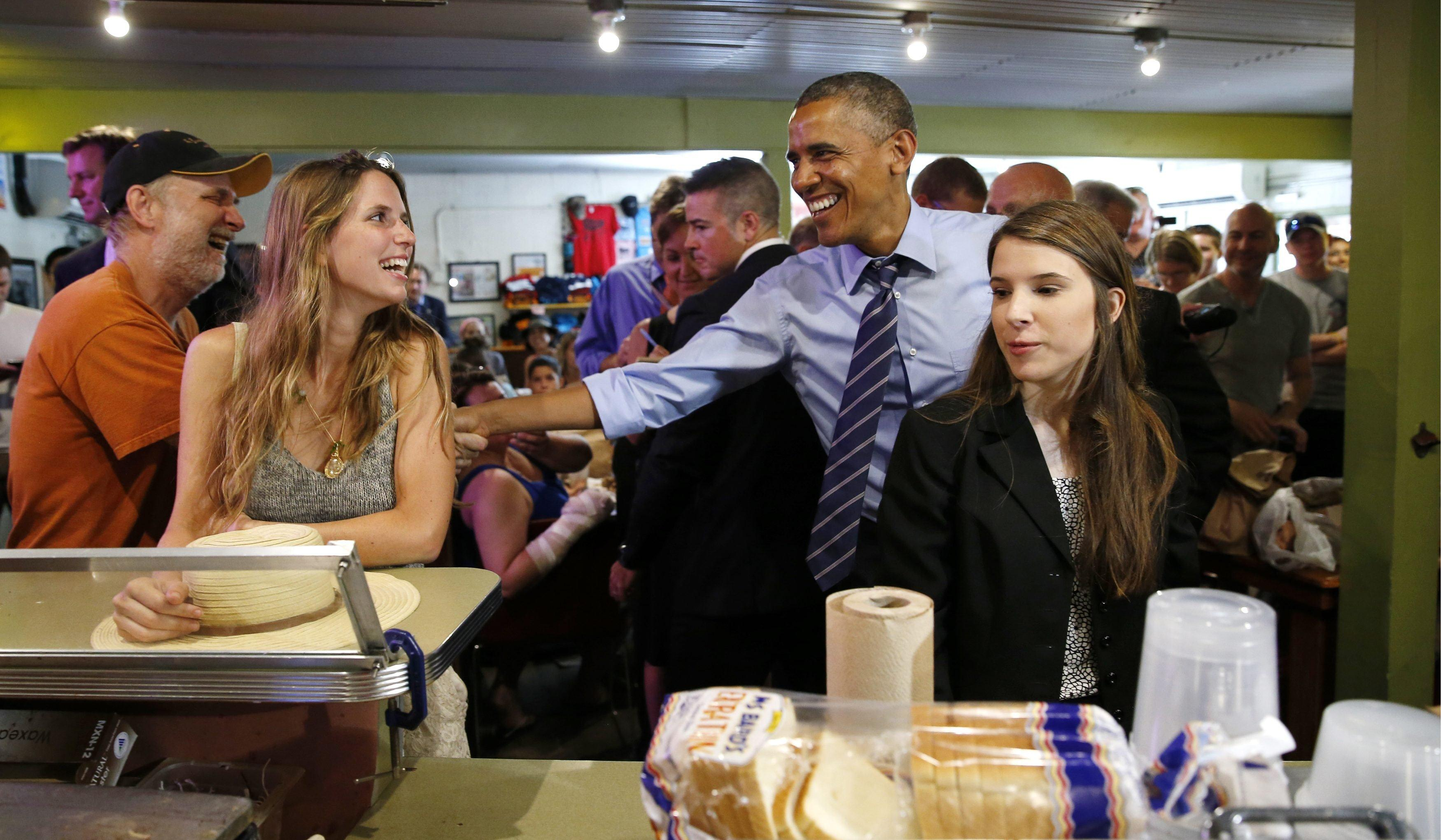 Image: Obama visits a barbeque restaurant in Austin, Texas