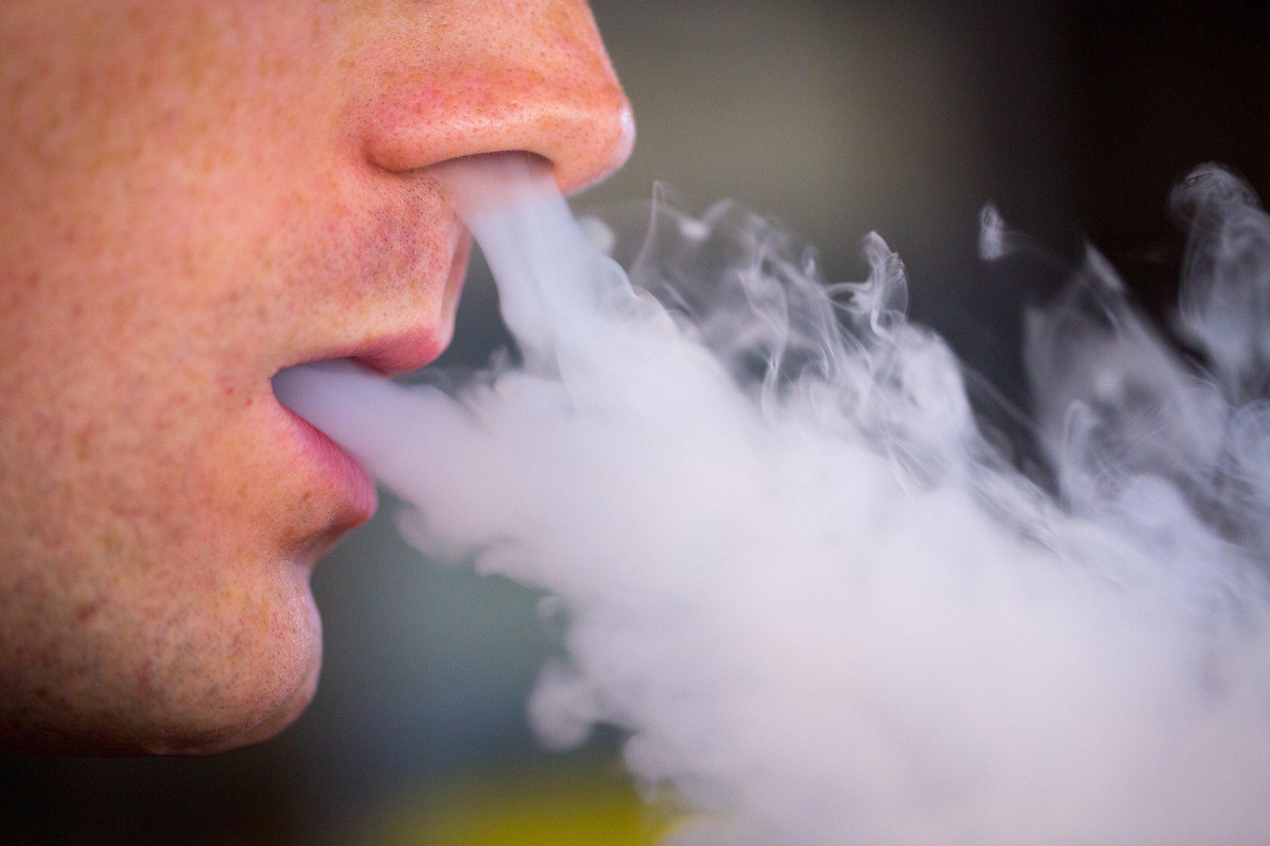 Image: E-cigarette user exhales vapor