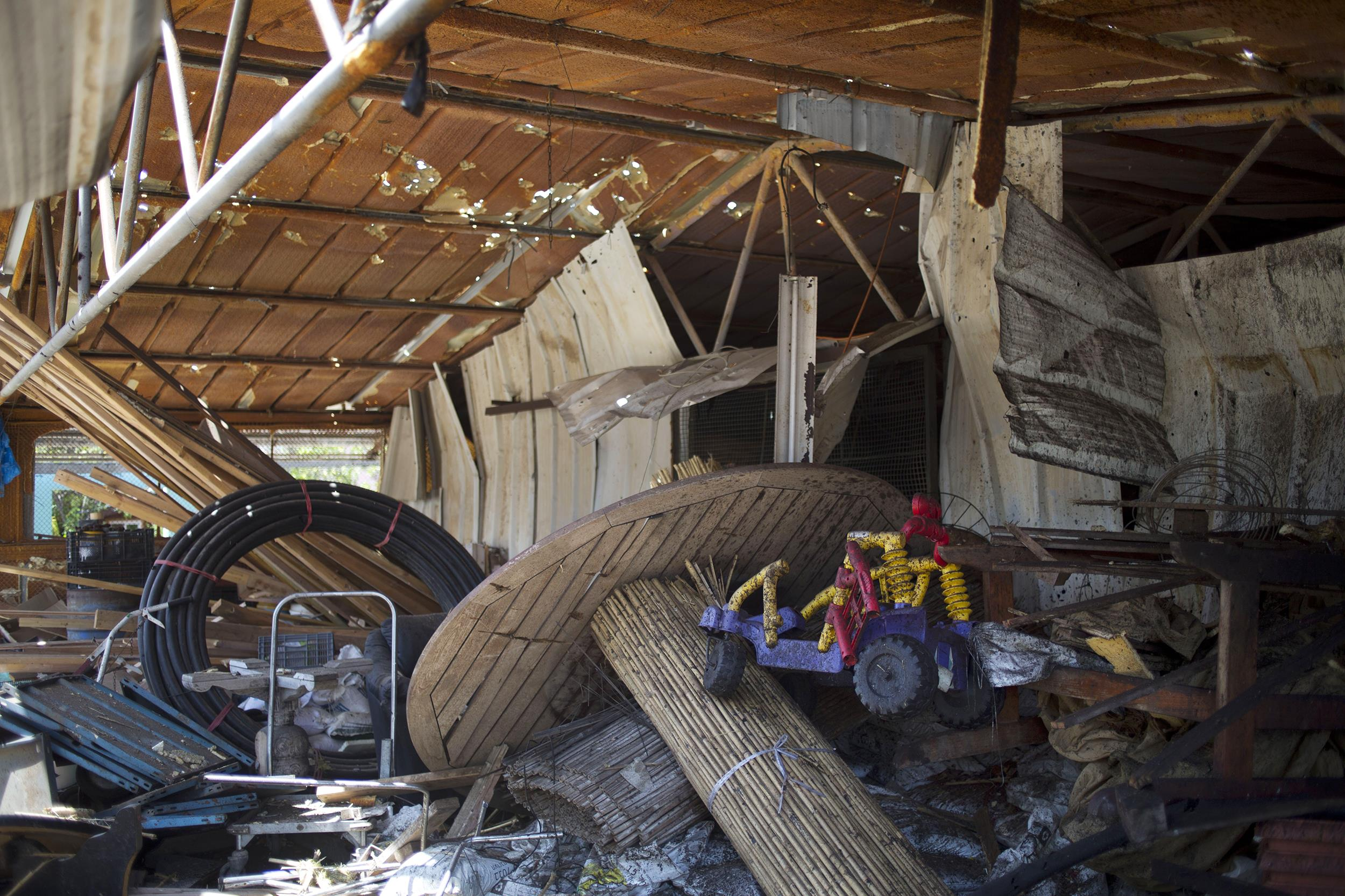 Image: A rocket fired by militants in south Lebanon damaged a building in Northern Israel