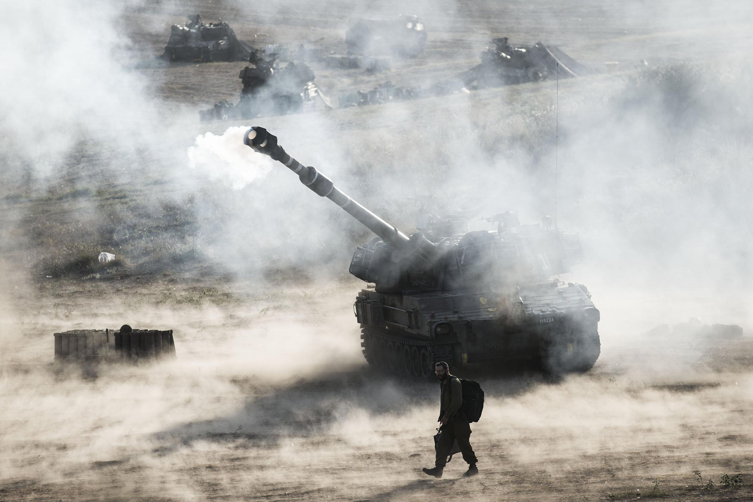 Image: Israeli artillery smoke can be seen on July 14, 2014 at the Israeli-Gaza border.