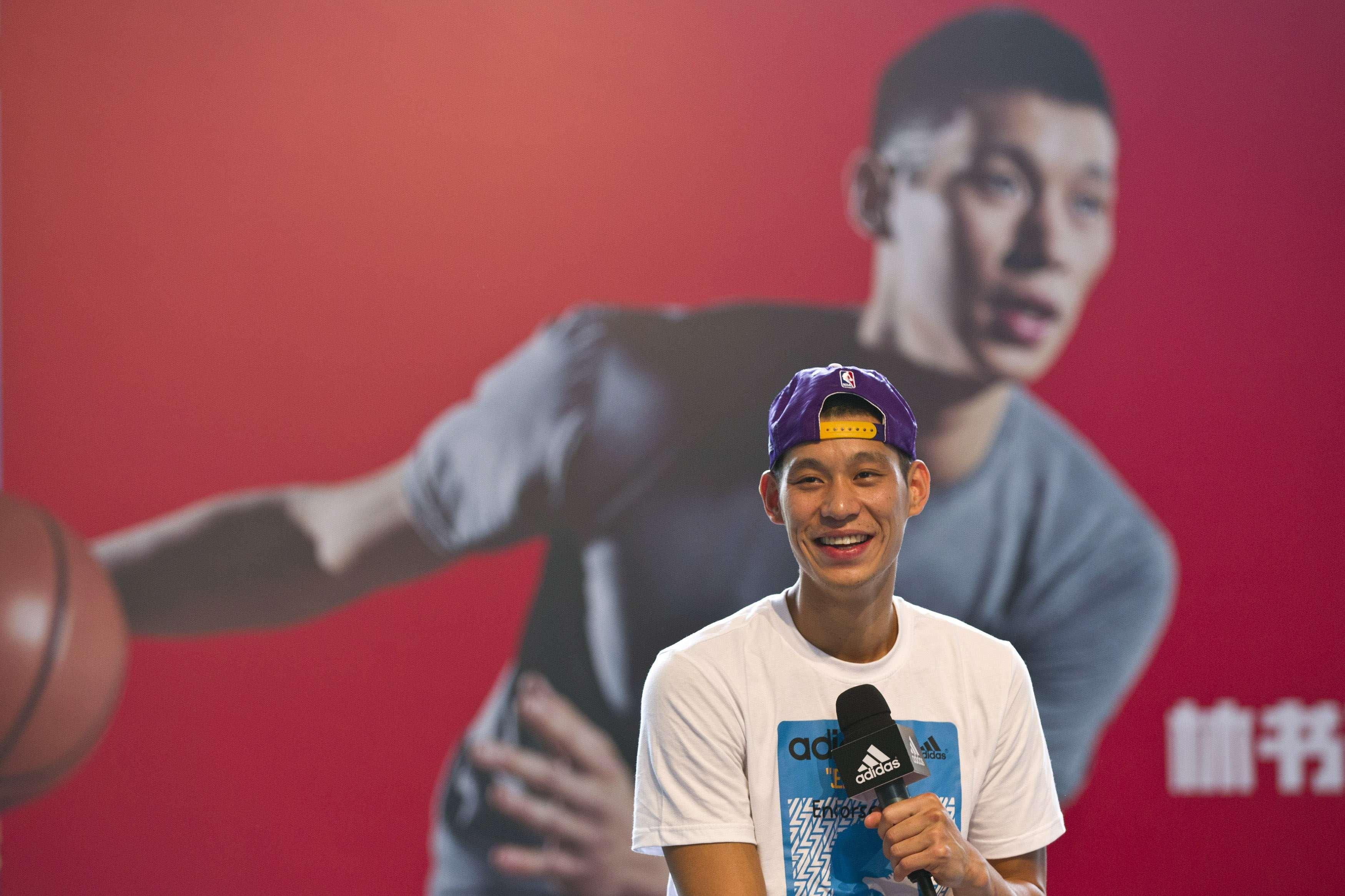 Image: NBA player Jeremy Lin of Los Angeles Lakers attends a promotional event as part of his Asia tour, in Shanghai