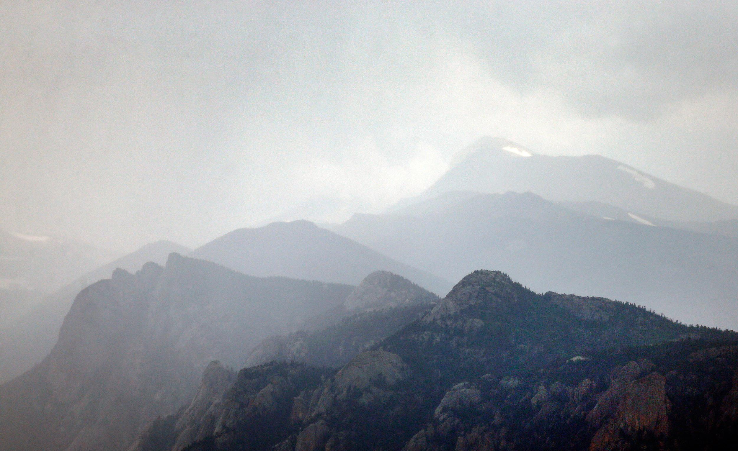 Image: A storm gathers over Rocky Mountain National Park just west of Estes Park, Colo.