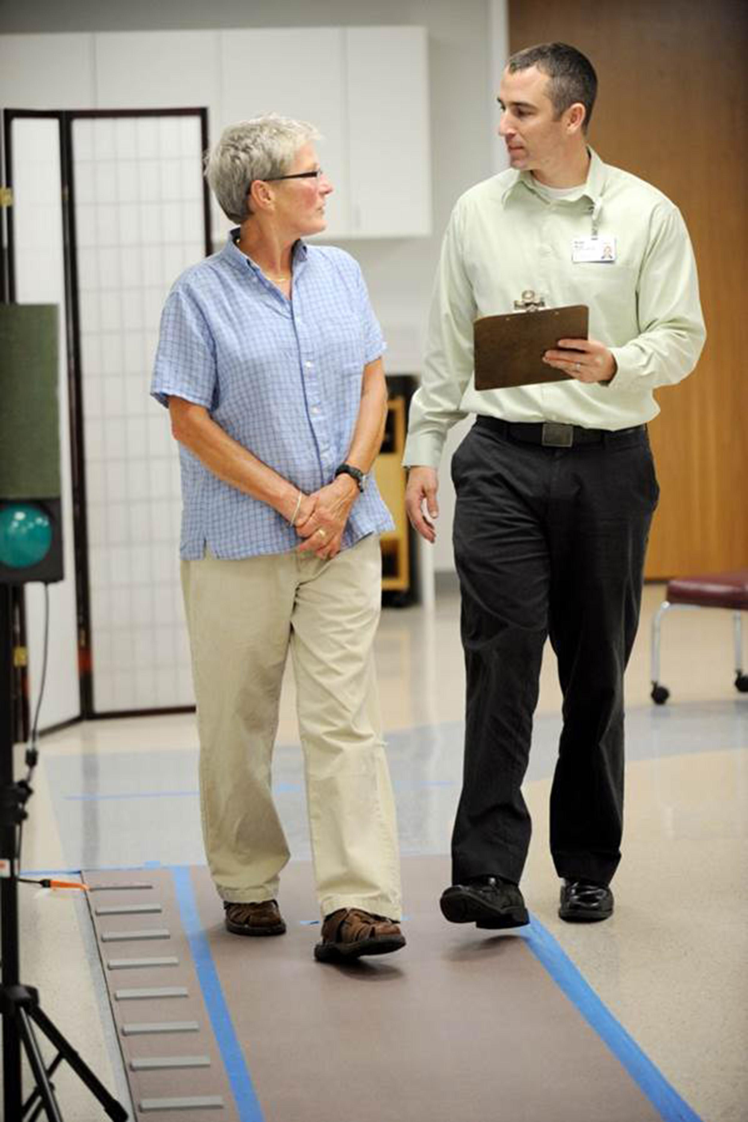 Bradley Manor, PhD performing a gait assessment