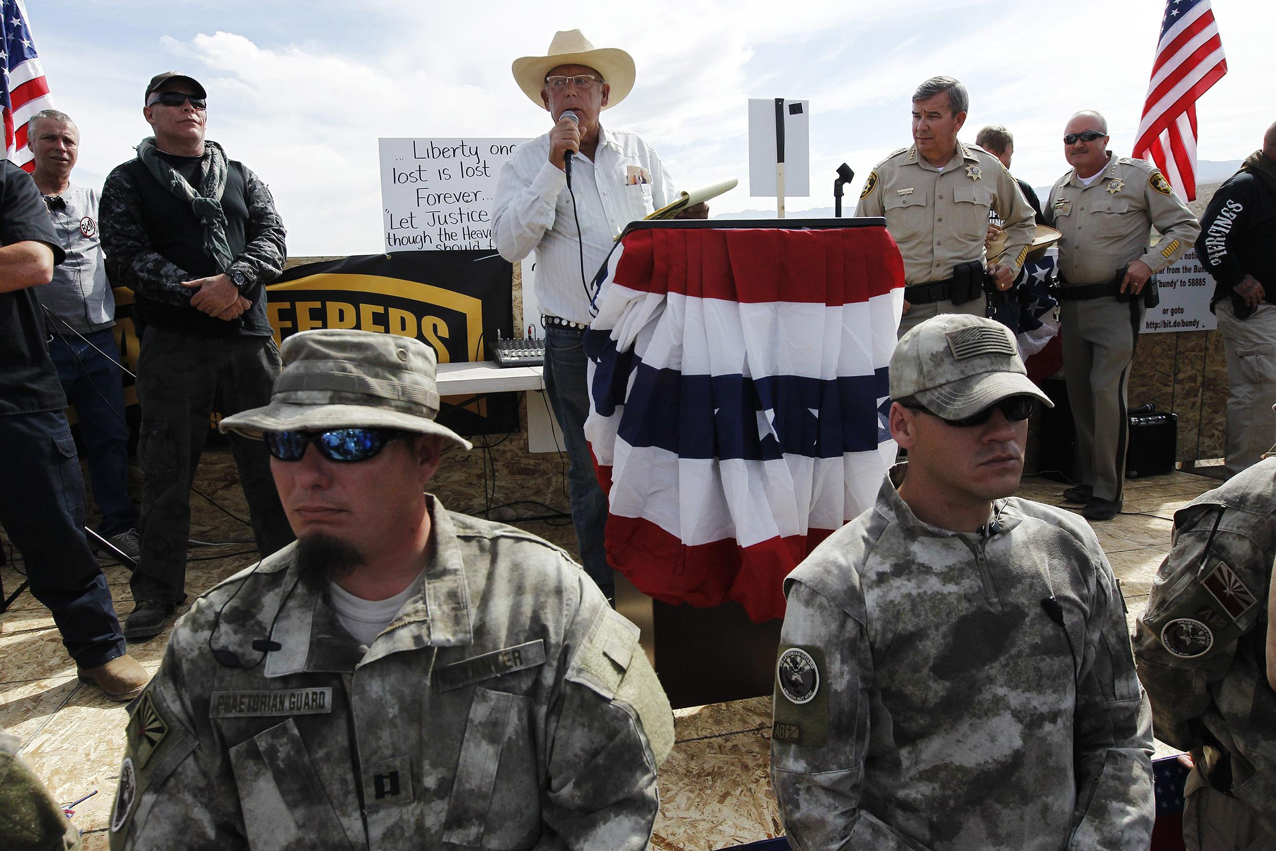 Image: Rancher Cliven Bundy addresses his supporters along side Clark County Sheriff Doug Gillespie, right, on April 12
