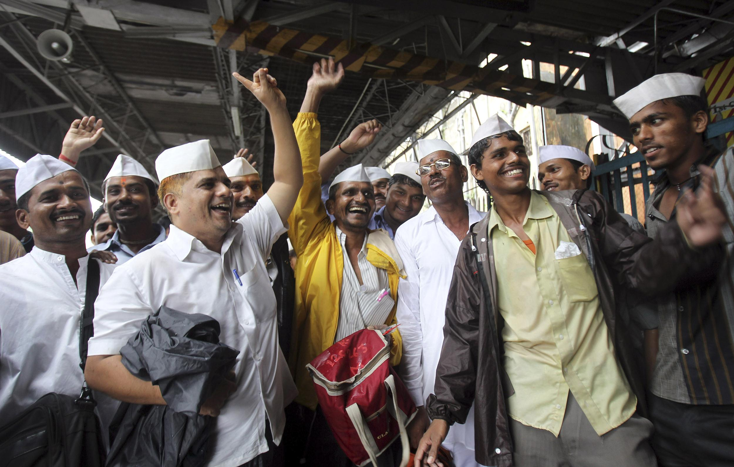 Image: Dabbawalas, or lunchbox delivery men, celebrate the birth of the Prince of Cambridge, the son of Britain's Prince William and Kate, Duchess of Cambridge, at a railway platform in Mumbai, India, on July 23, 2013