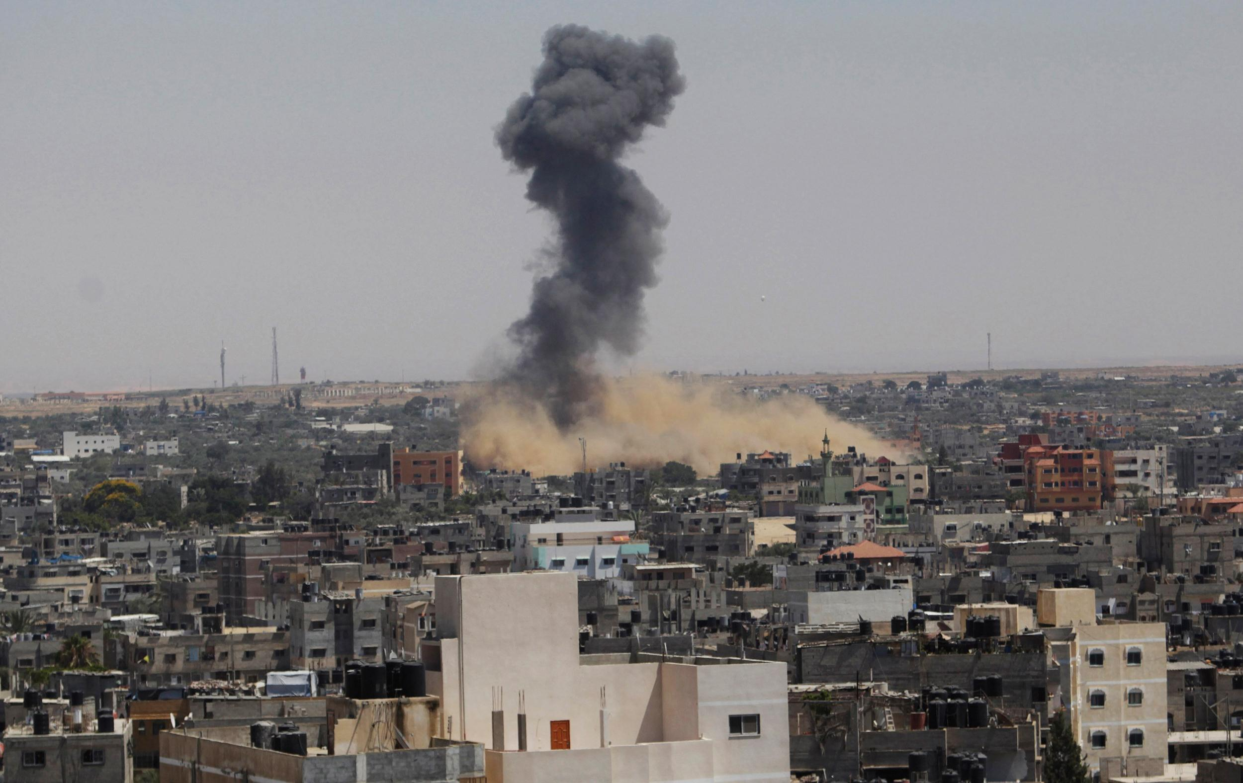 Image: Smoke rises following what witnesses said was an Israeli air strike in Rafah in the southern Gaza Strip