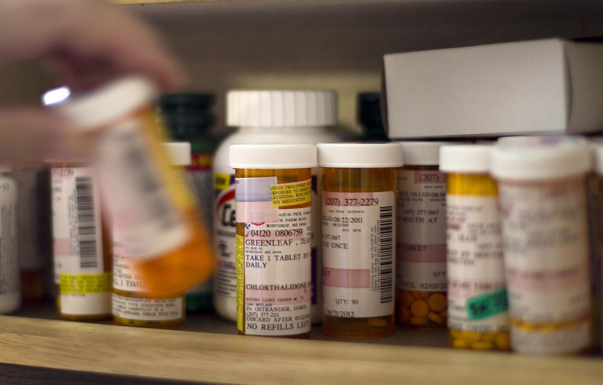 Image: A woman returns her medication to a cabinet at her home in Winthrop, Maine on Mat 11, 2012.