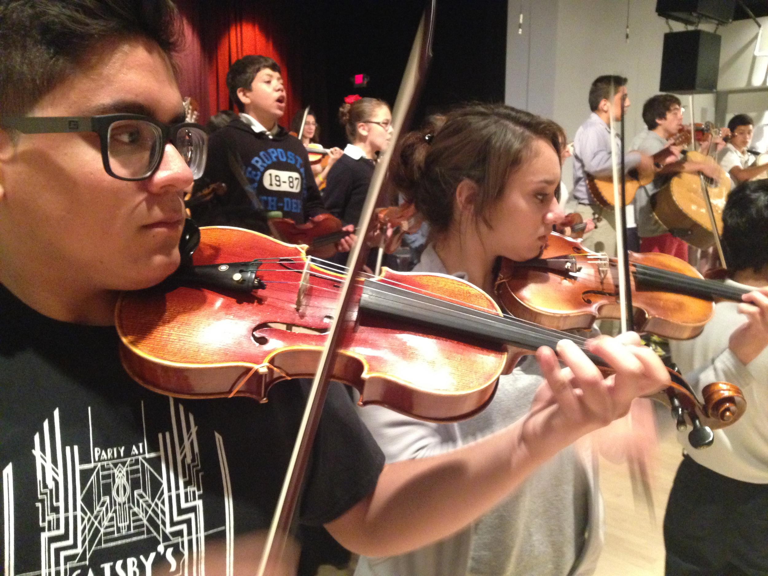 Image: Students at the Latino Arts String Program, at the United Community Center in Milwaukee, Wisconsin.