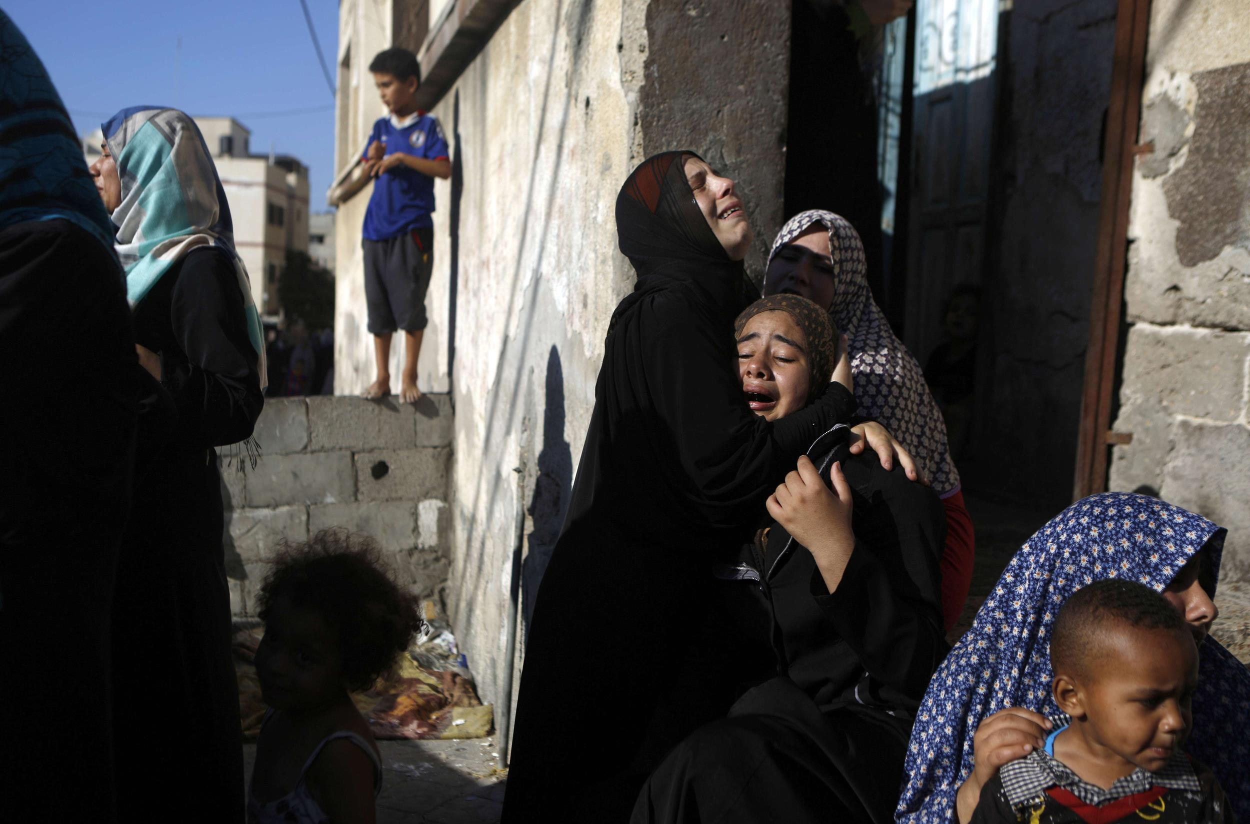 Image: Palestinian women react during the funeral of four boys, all from the Bakr family, killed during Israeli shelling in Gaza City on July 16, 2014.