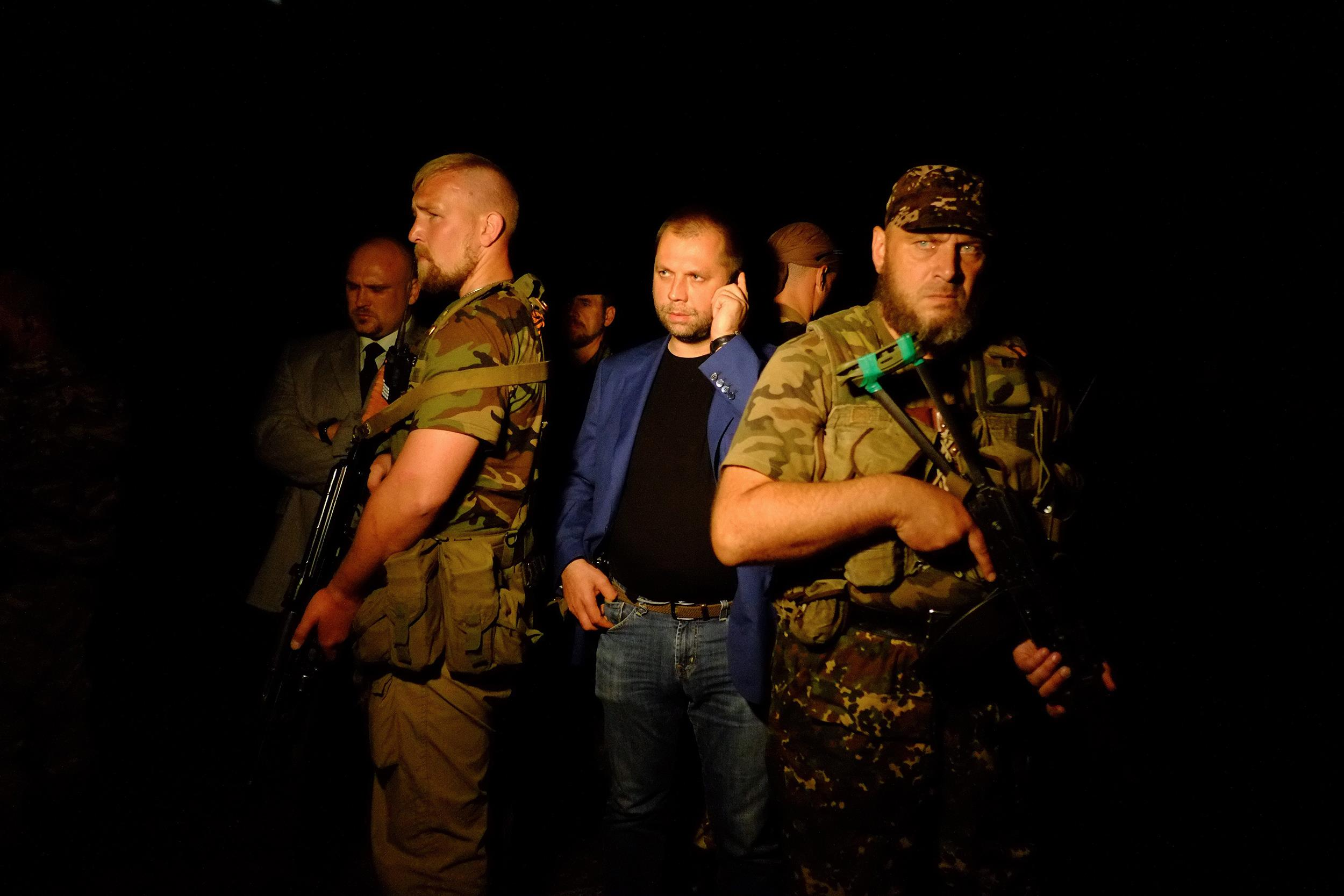 Image: Self-proclaimed Prime Minister of the pro-Russian separatist 'Donetsk People's Republic' Alexander Borodai, center, stands as he arrives on the site of the crash of a Malaysian airliner carrying 298 people from Amsterdam to Kuala Lumpur