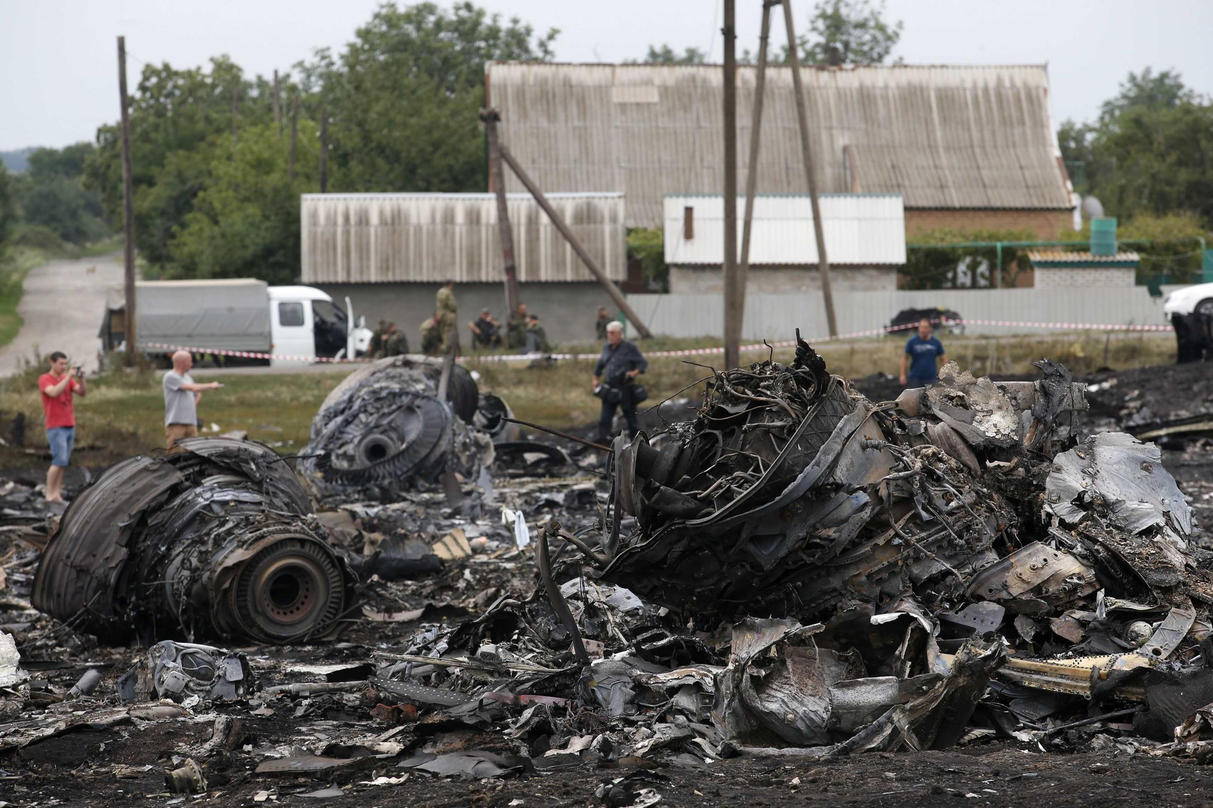 Image: Debris is seen at the site of Thursday's Malaysia Airlines Boeing 777 plane crash near the settlement of Grabovo, in the Donetsk region