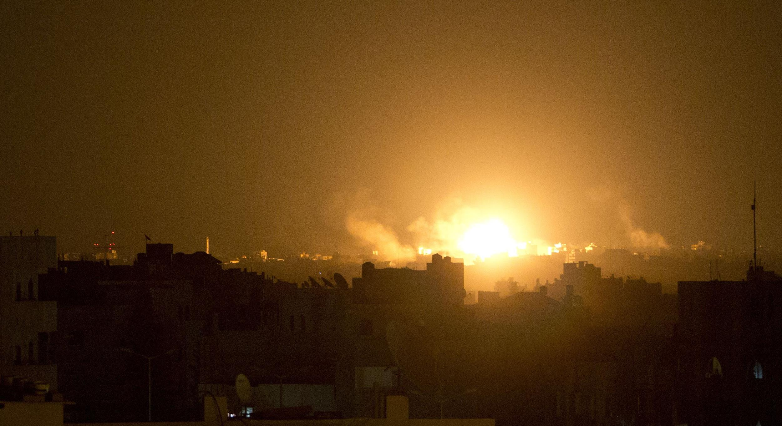 Image: A ball of fire explodes during an Israeli shelling in the eastern part of Gaza City