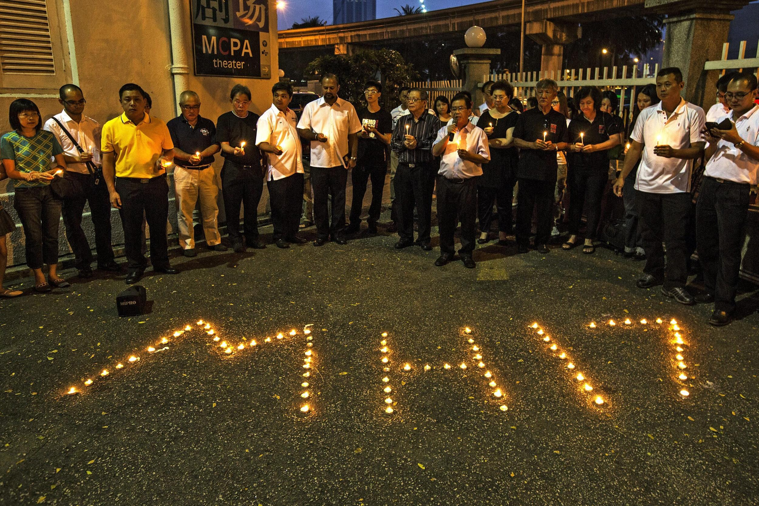 Image: Vigil for victims of MH17 attack in Kuala Lumpur, Malaysia, on Saturday