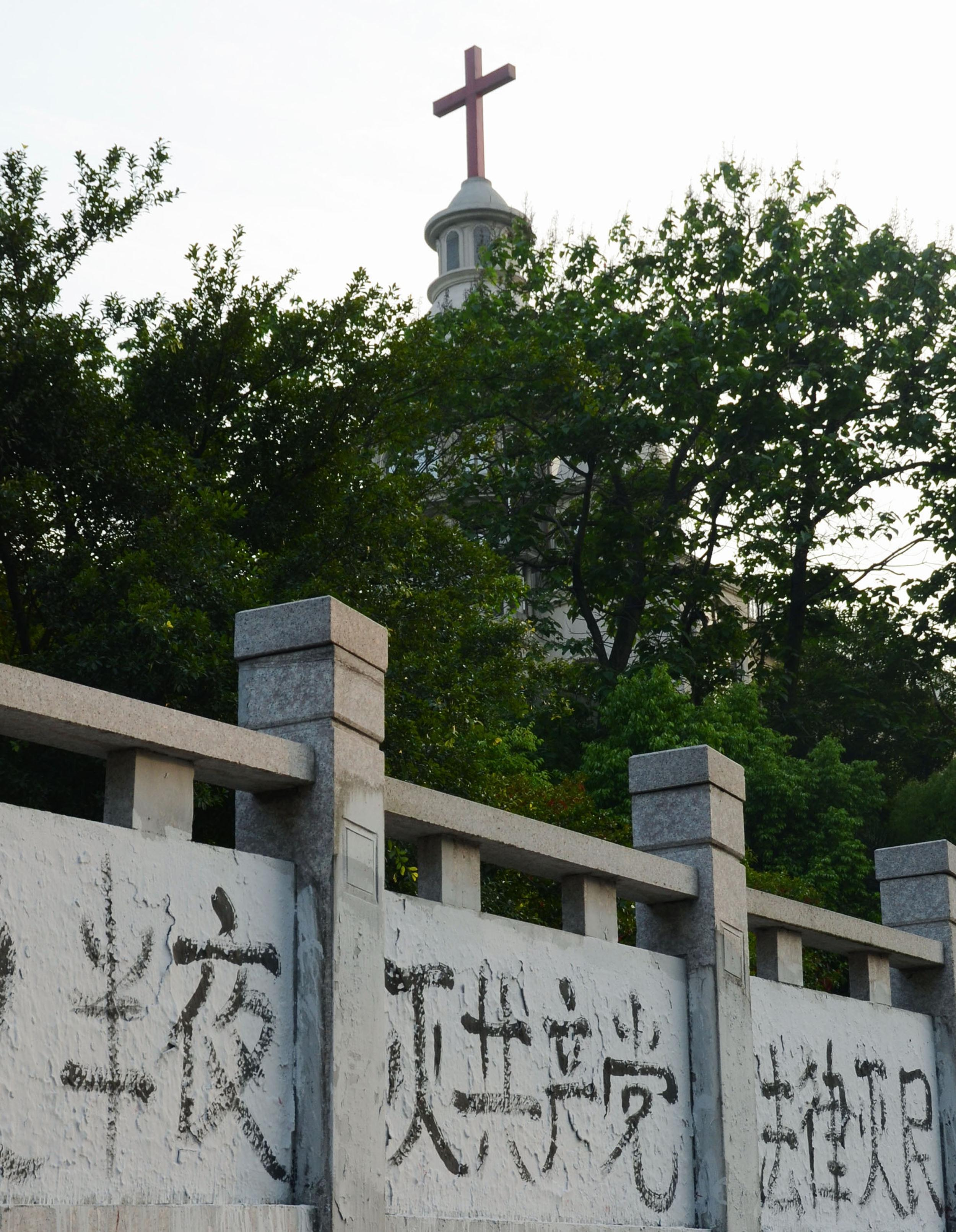 Graffiti denouncing the Chinese Communist Party on a wall photographed on April 28, 2014, near a church in Wenzhou, Zhejiang Province