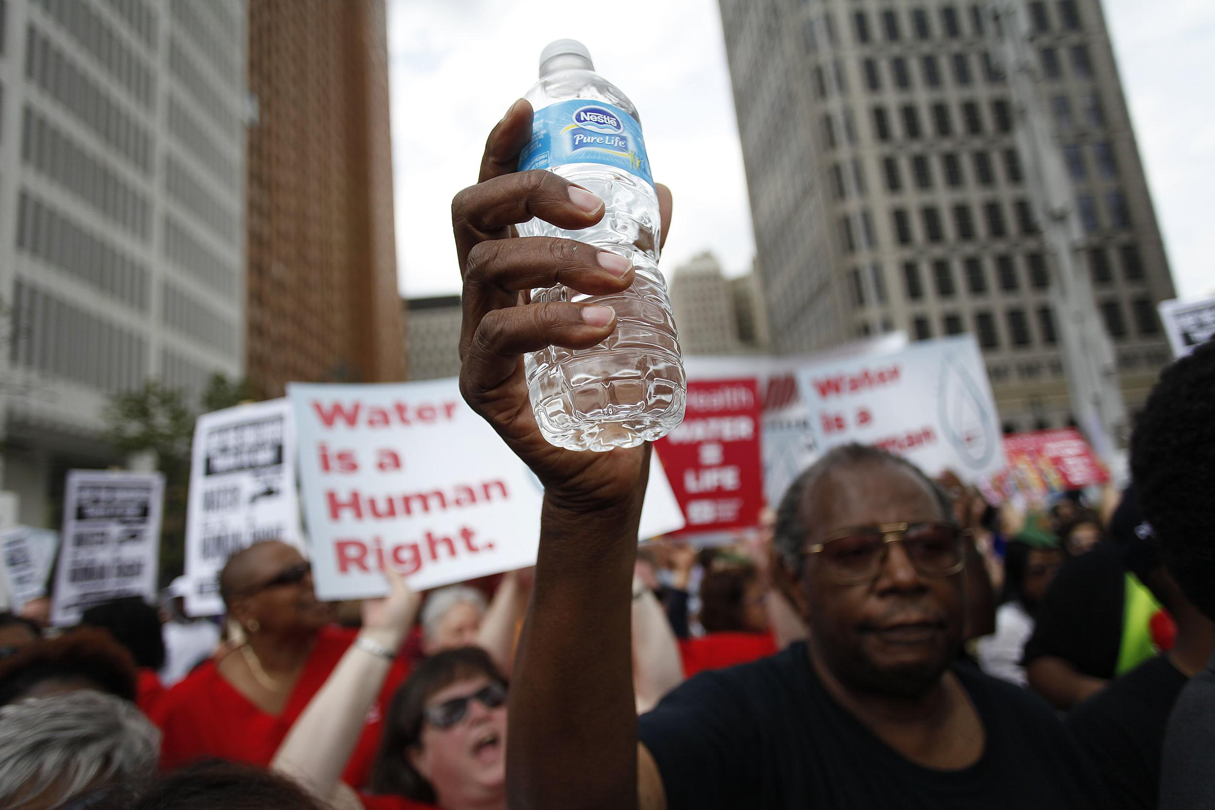 Image: Protest Advocate Water Access Is Basic Right, After City Of Detroit Starts Cutting Service