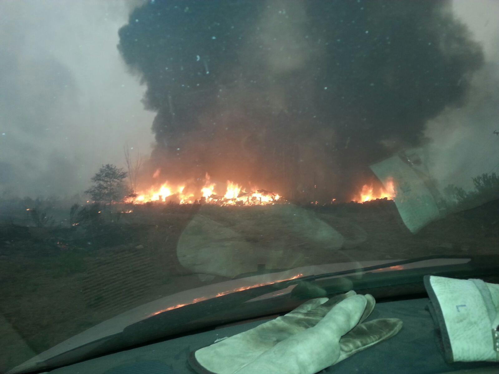 IMAGE: Washington's largest wildfire ever consumes the home of firefighter Justin Crump