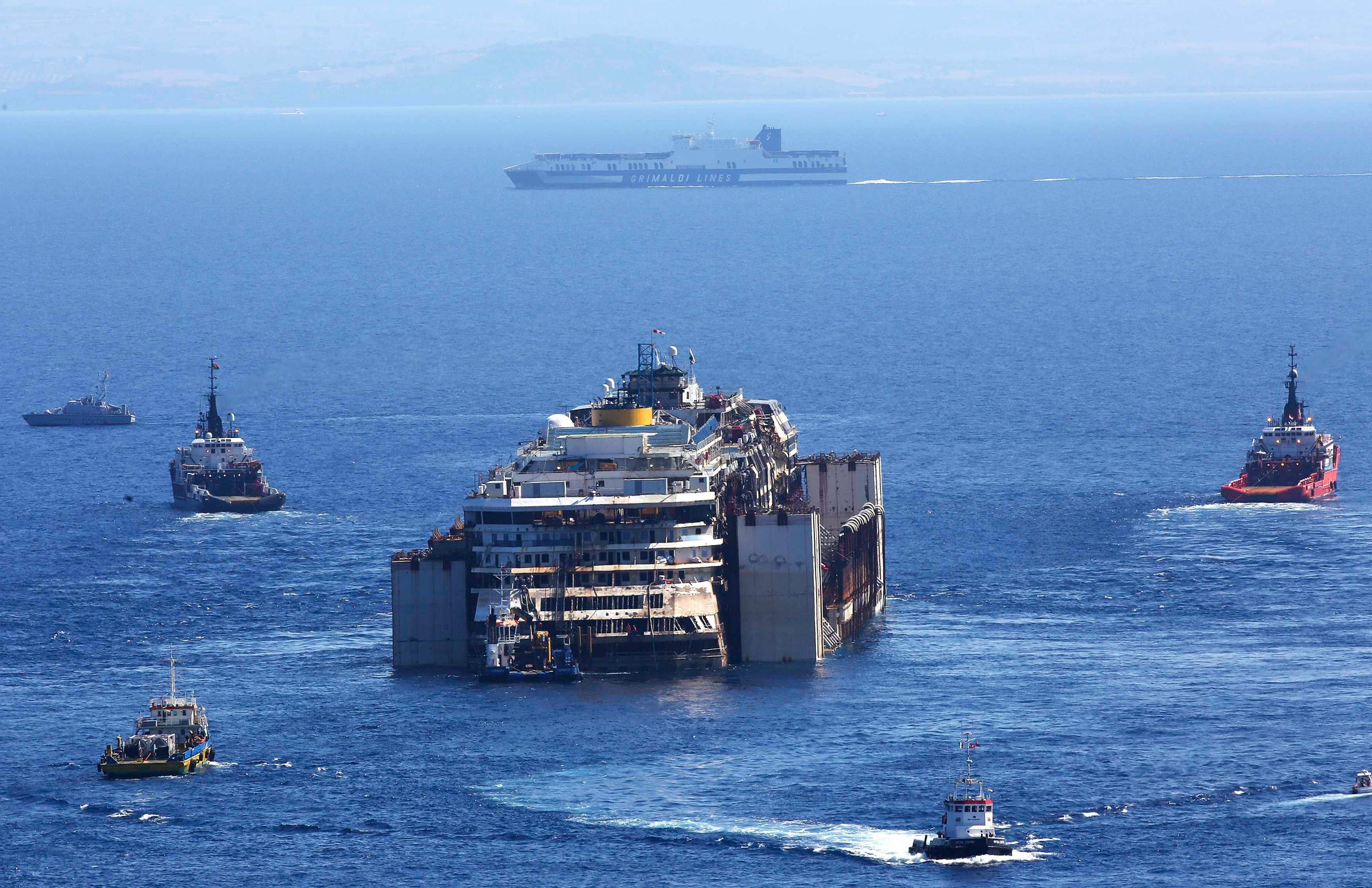 Moving Moment: Wrecked Concordia Makes Final Voyage