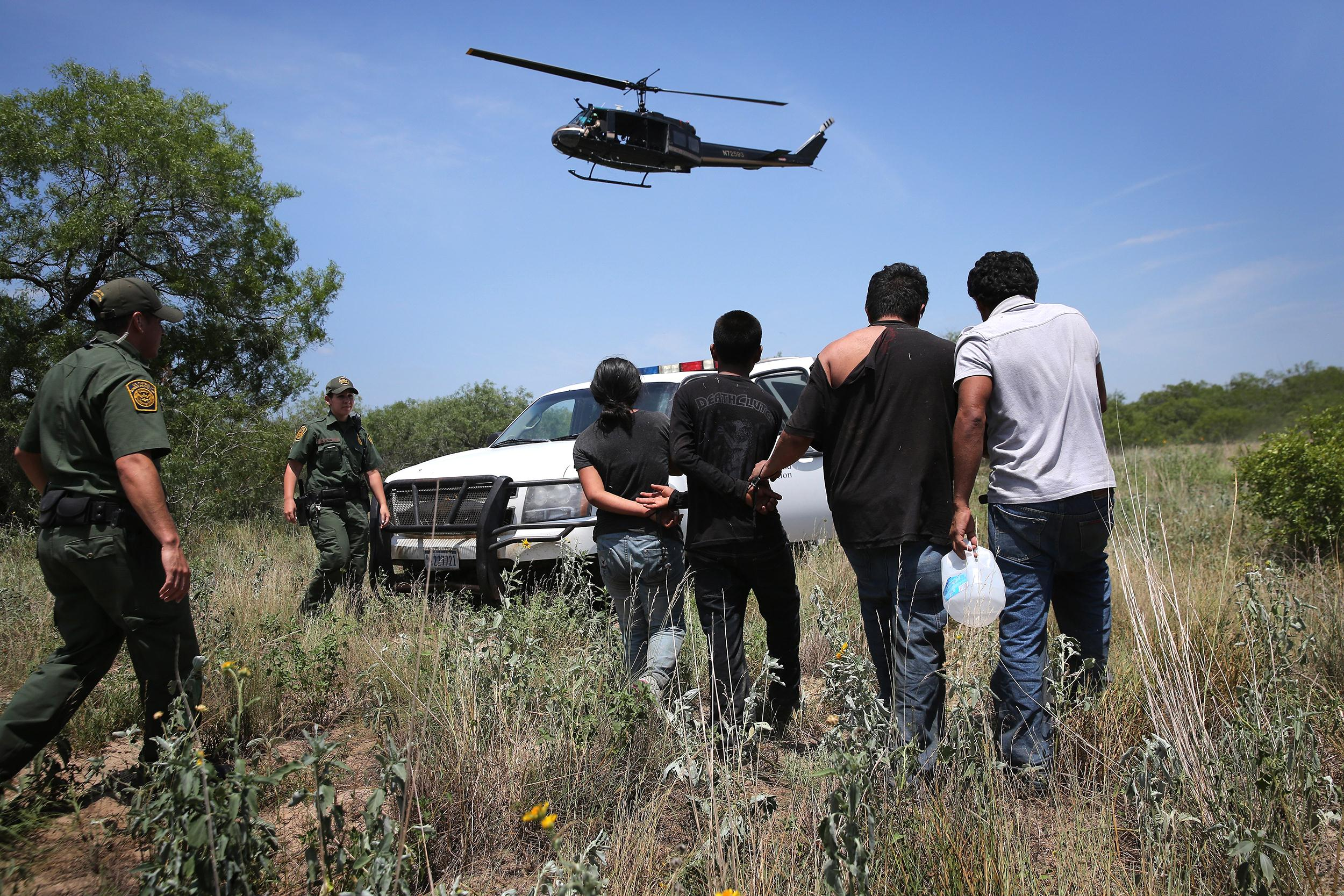 Image: U.S. Customs and Border Protection agents take undocumented immigrants into custody near Falfurrias, Texas