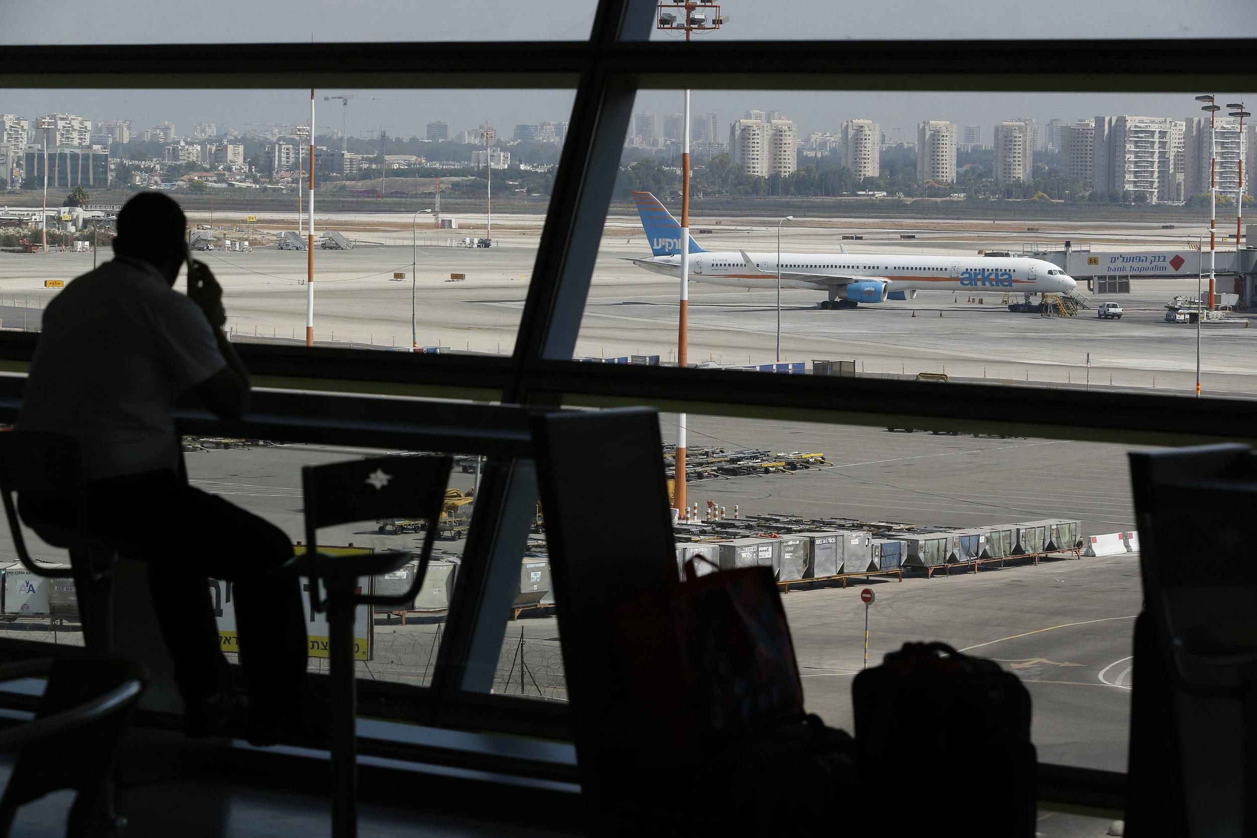 Image: A passenger looks out of a window at Ben Gurion airport on Thursday