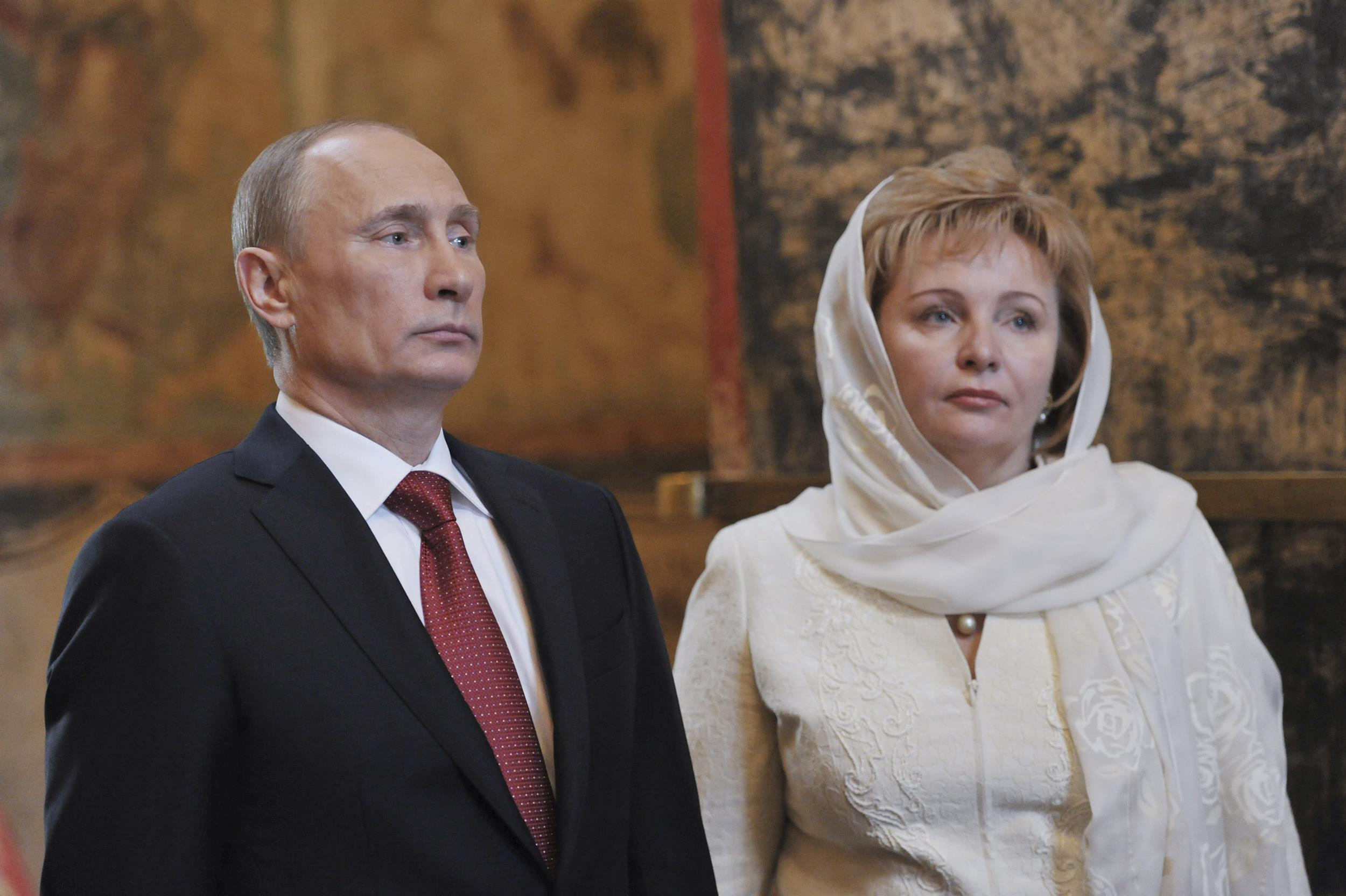 Image: File photo of Putin and his wife attending a service in Moscow